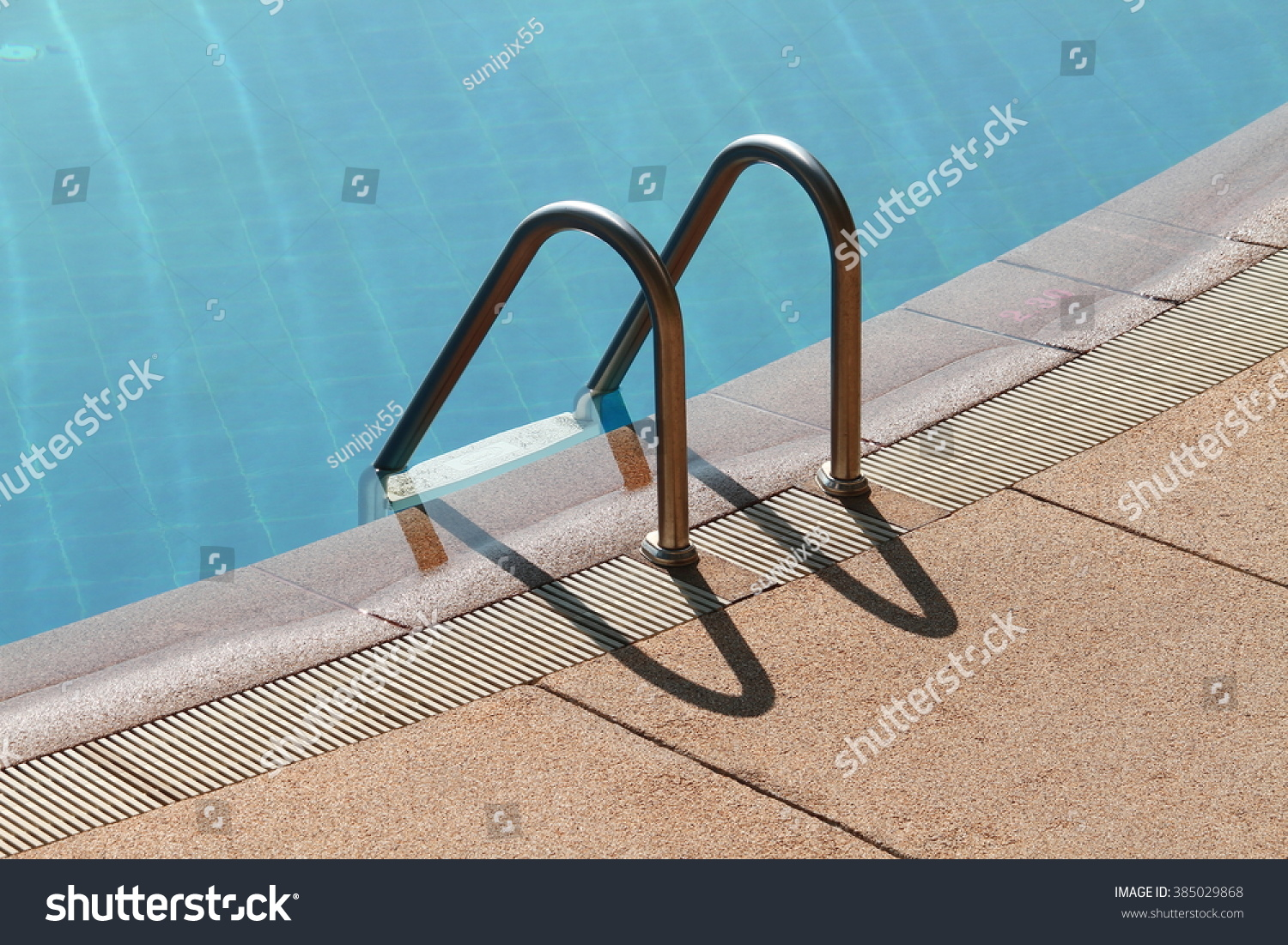 Grab Bars Ladder In The Blue Swimming Pool Stock Photo 385029868 Shutterstock