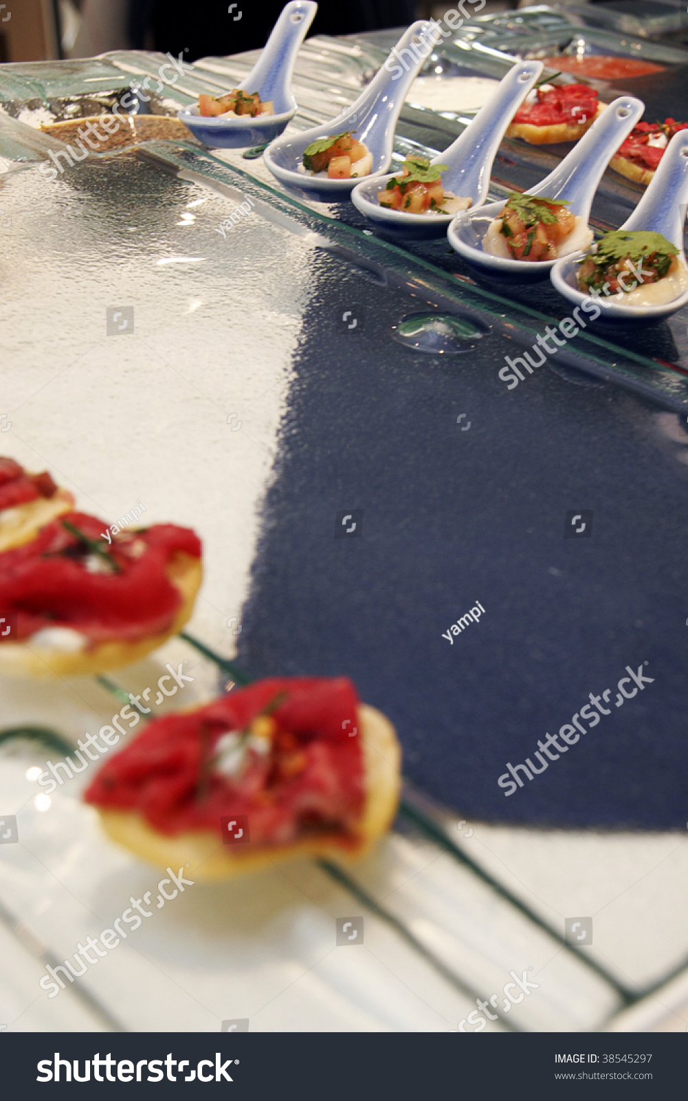 Gourmet canapes on square glass serving tray stock photo for Canape serving platters