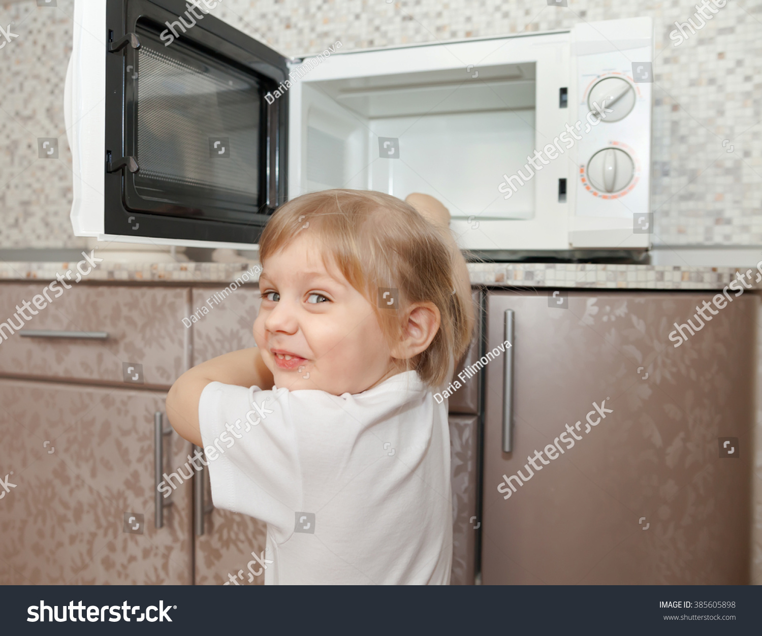 royalty child out supervision of parents  child out supervision of parents playing microwave stock photo
