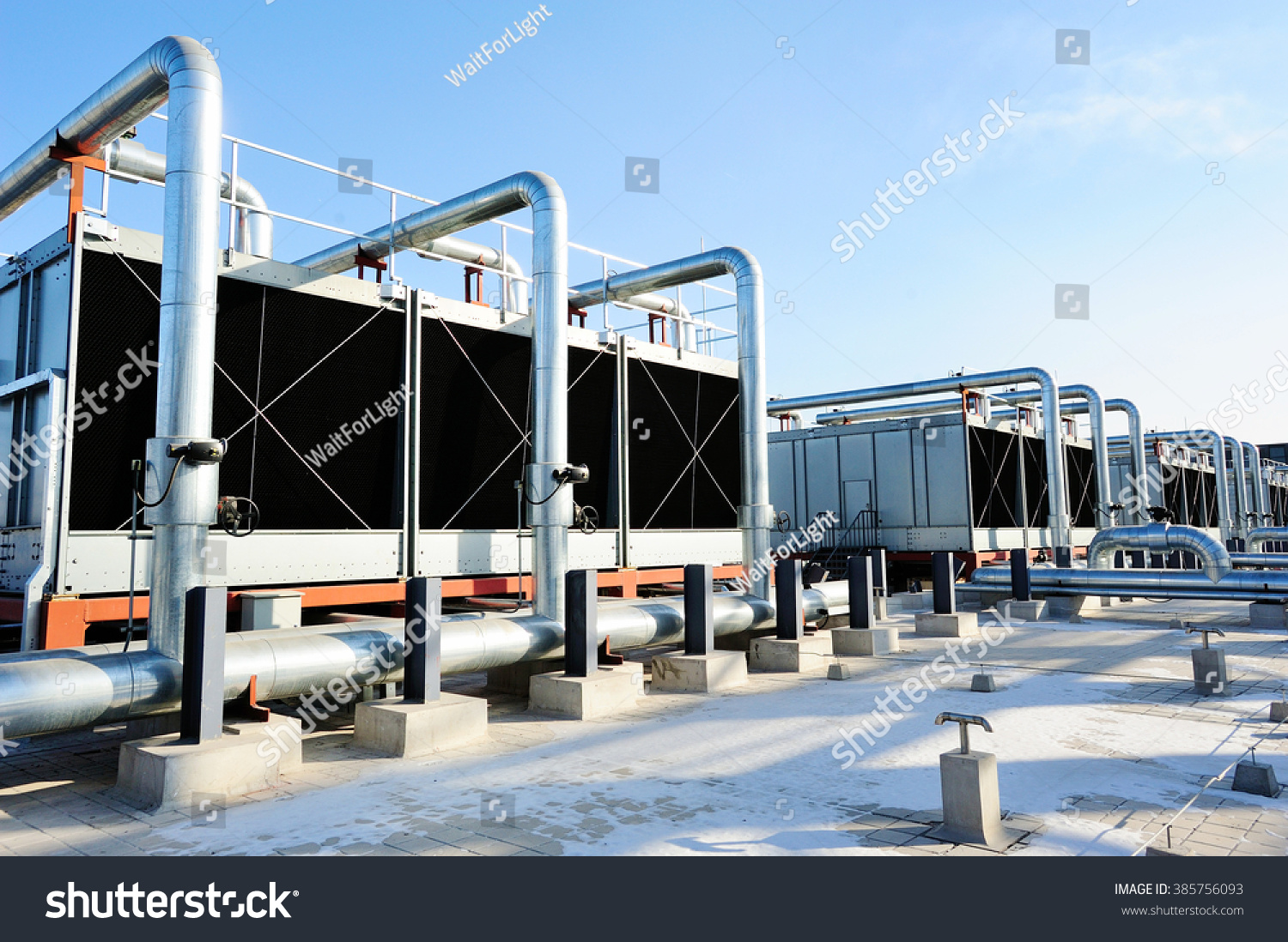Sets of cooling towers in data center building. #385756093