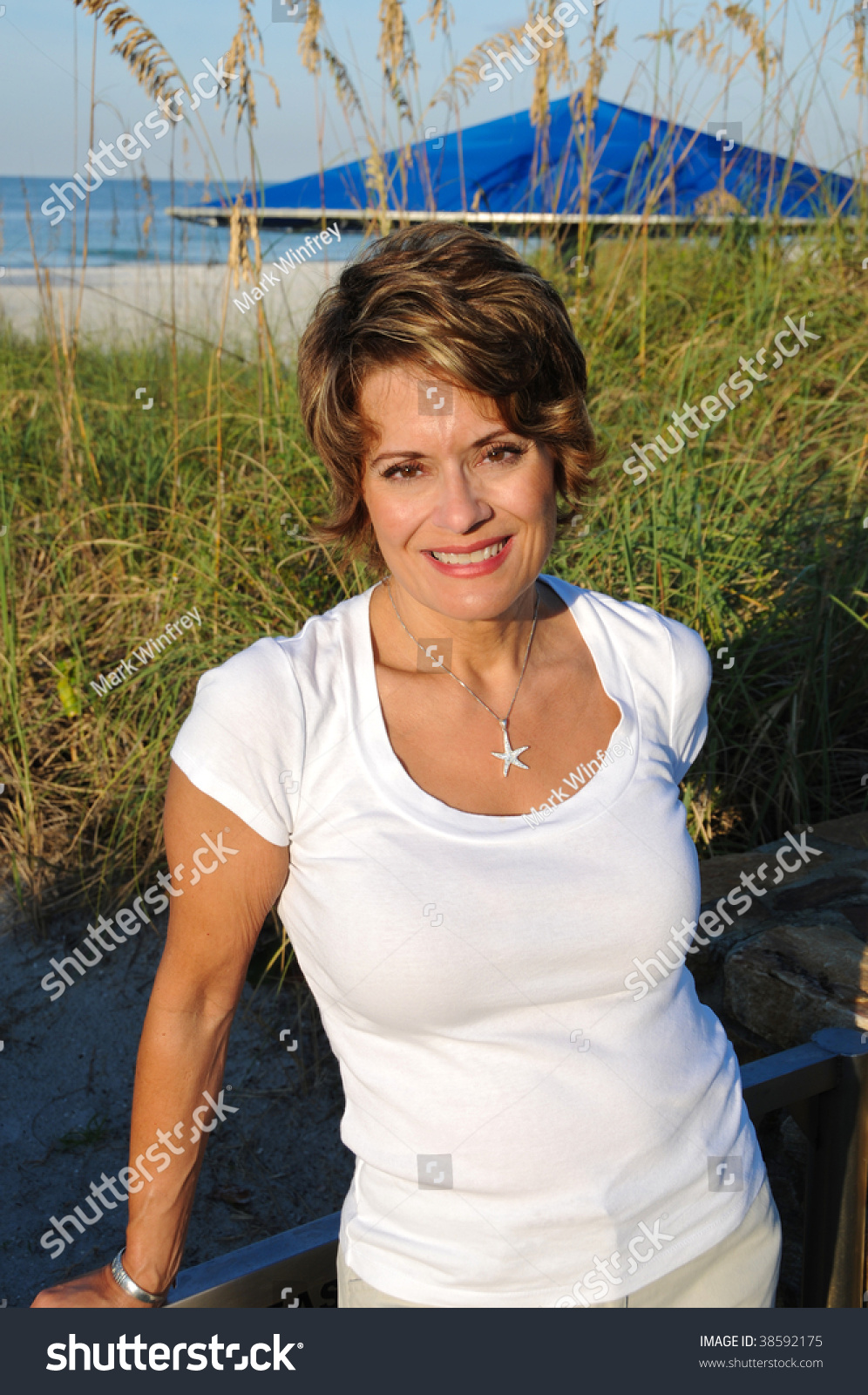 Attractive Woman enjoying the early morning sun at the beach