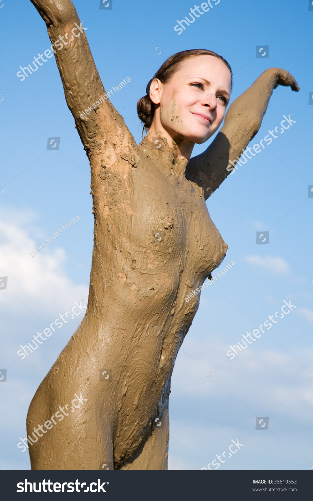 Naked girls in the mud