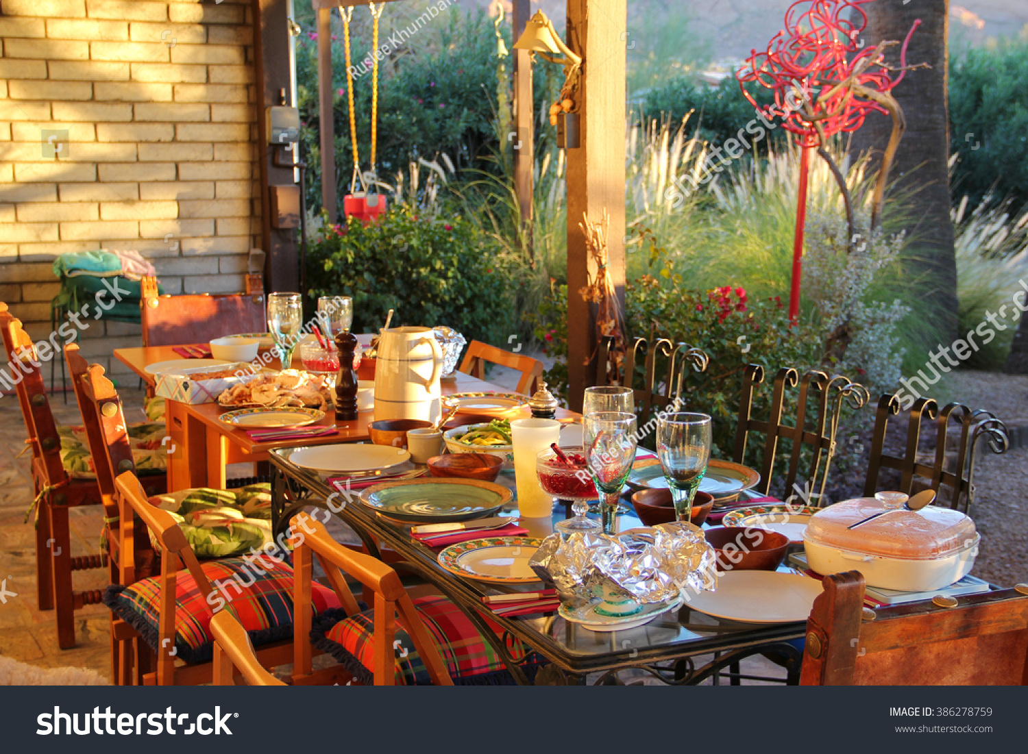 Dining table on warm sunny day stock photo 386278759 for Dinner on the terrace