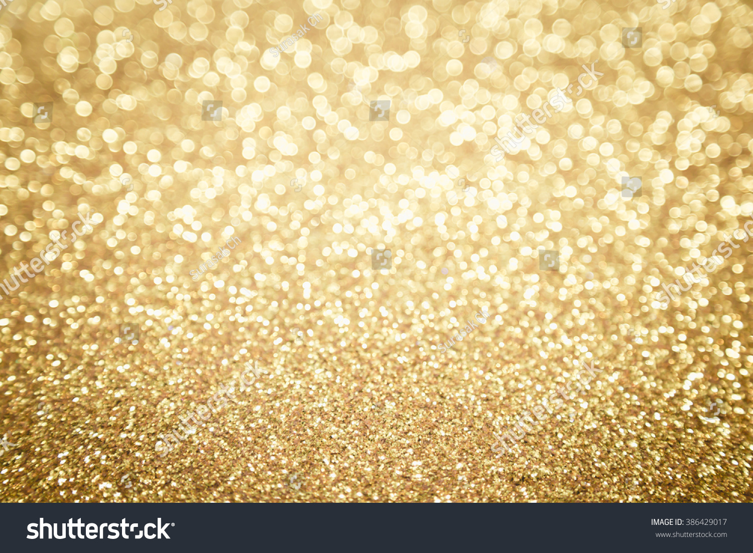 Abstract Blurred Gold Glitter Bokeh… Stock Photo 386429017