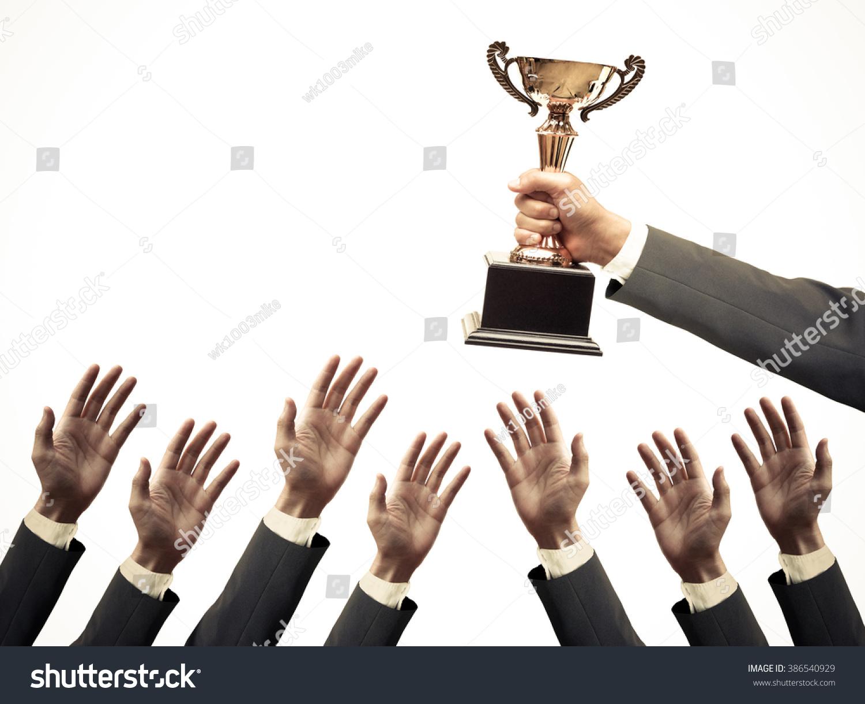 Technology Management Image: Hand Businessman Holding Golden Trophy Over Stock Photo