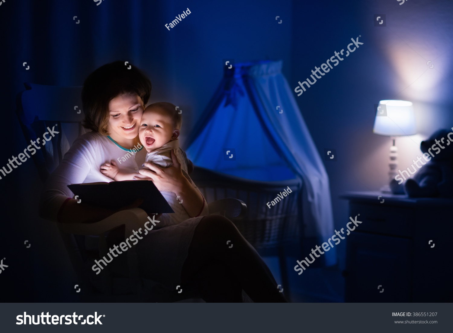 Baby bed next to mom - Mother And Baby Reading A Book In Dark Bedroom Mom And Child Read Books Before