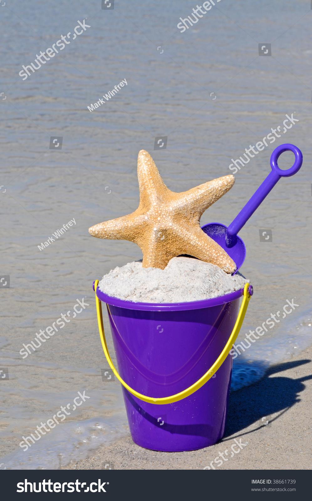 stock-photo-beach-bucket-full-of-sand-wi