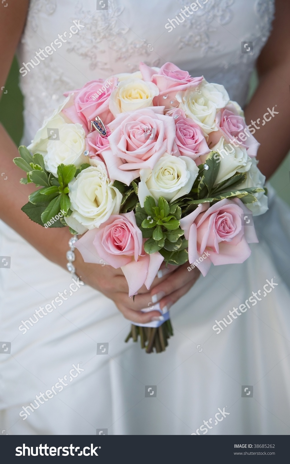 Pink And White Rose Wedding Bouquet Held By Bride