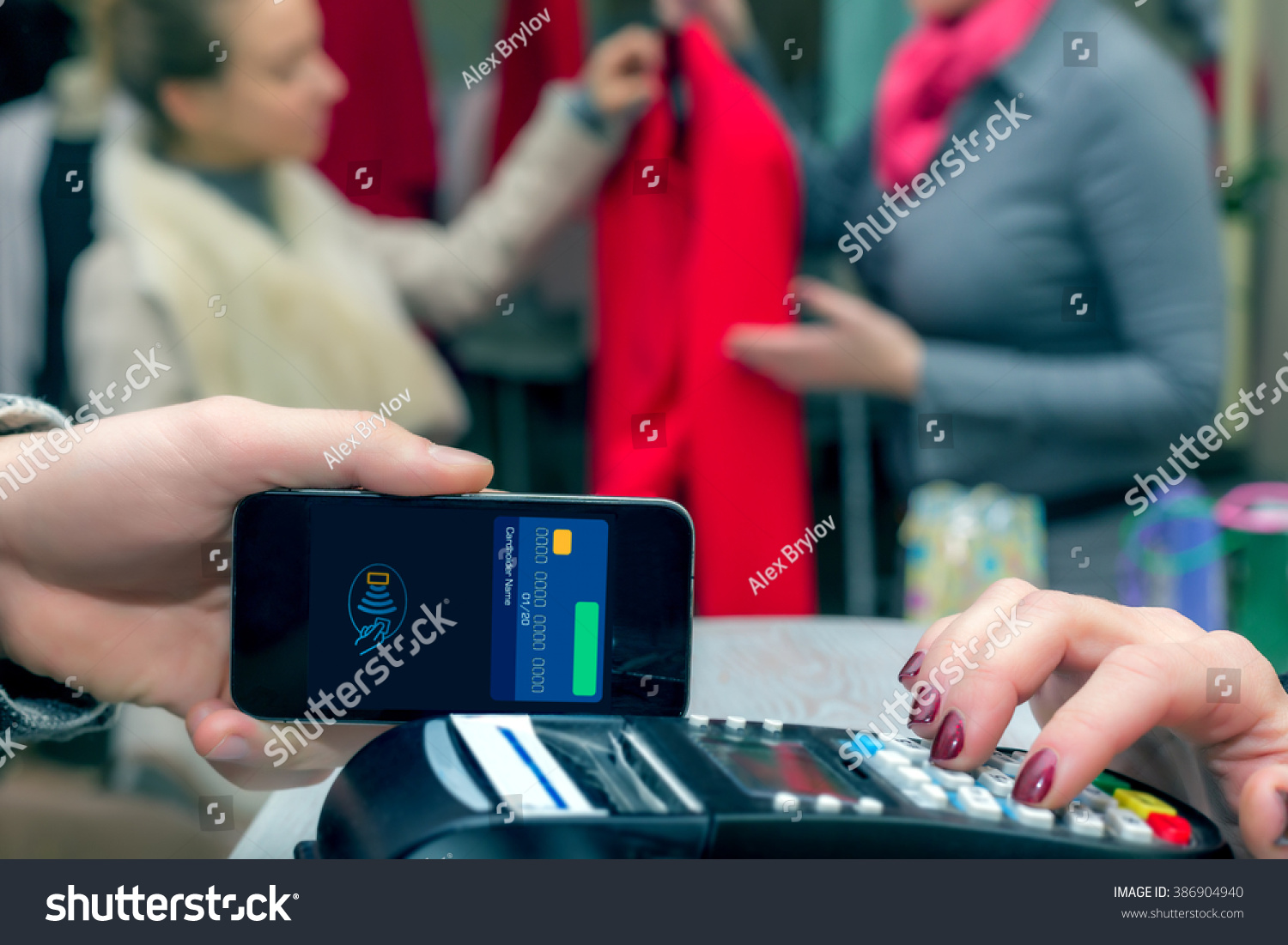 Man Completing Mobile Payment Using Modern Stock Photo Edit Now Phone Repair In Electronic Lab Working Place Royalty Free Smart Technology At Store Cashiers Desk With Terminal Salesperson