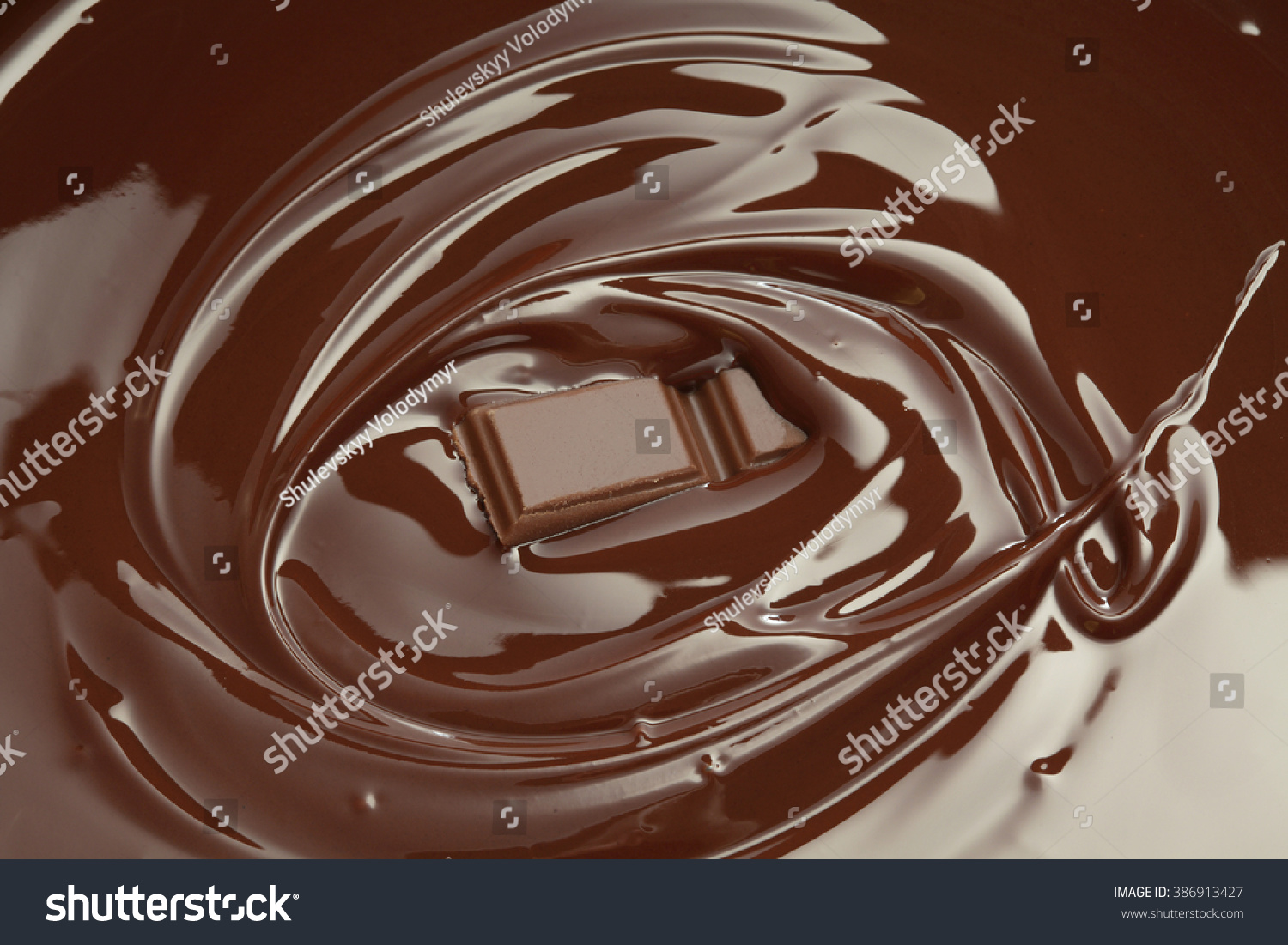 melted chocolate swirl chocolate bar piece stock photo