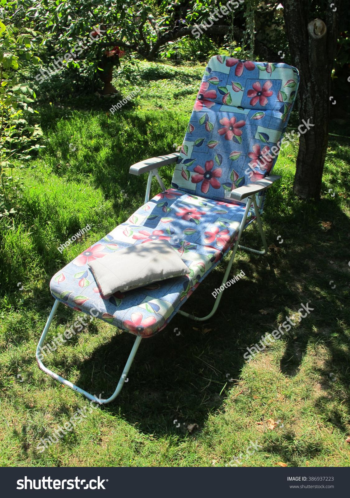 Chaiselongue blooming summer sunny garden stock photo for Garden chaise longue