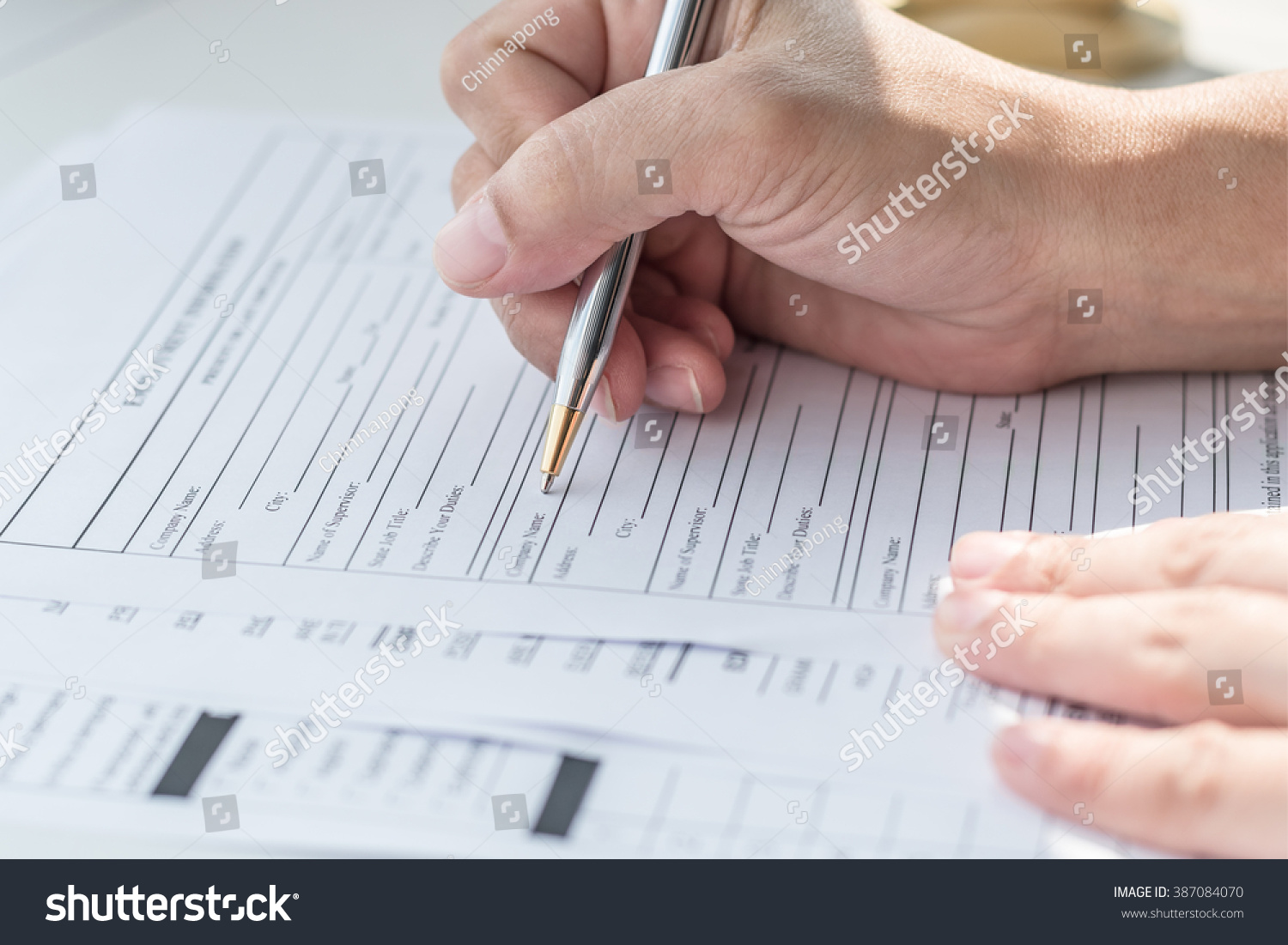 applicant filling in company application form document applying for