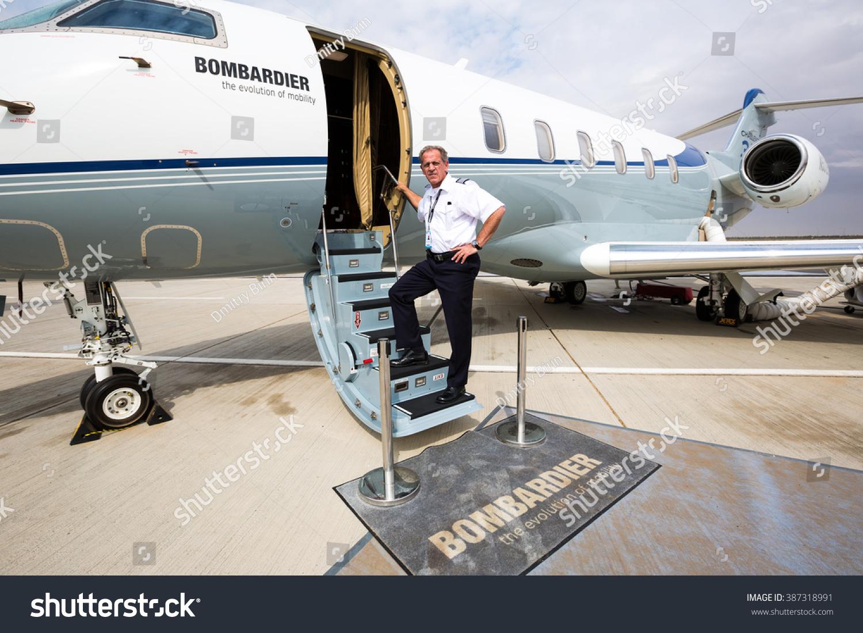 Dubai uae november 12 captain pilot posing near aircraft bombardier challenger 350