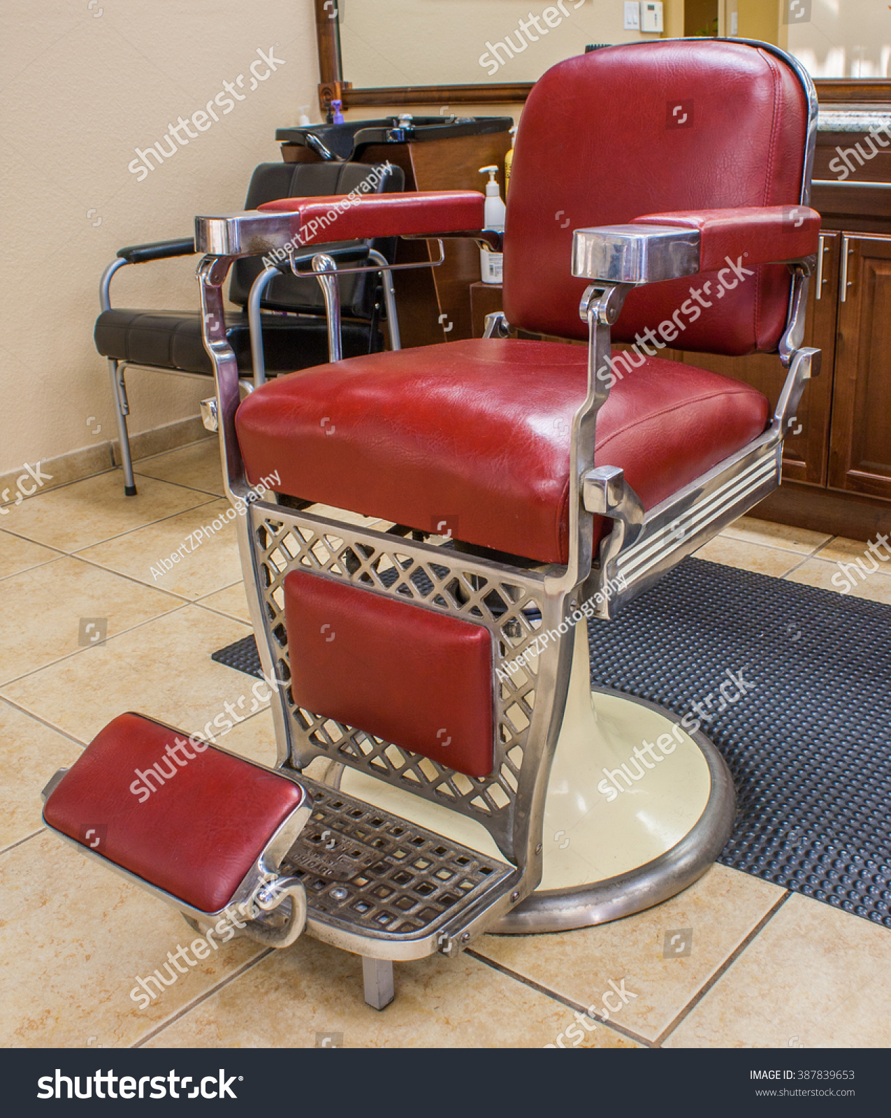 Classic barber shop chairs - Classic Barber Chair In A Barbershop Setting Stock