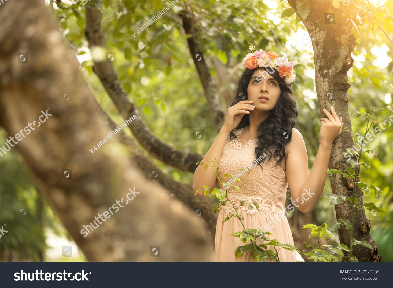Beautiful indian young girl head flower stock photo edit now beautiful indian young girl head with flower crown in garden izmirmasajfo
