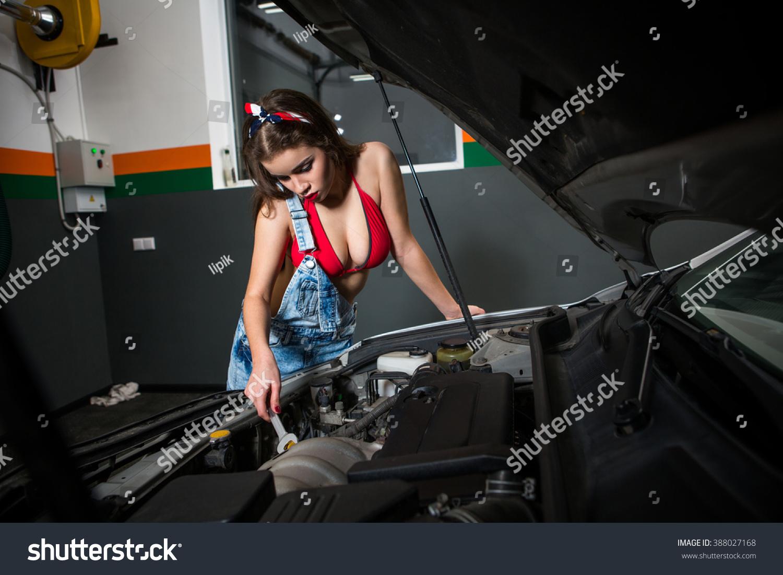Mechanic woman repairing motor electric parts stock photo for Castellano electric motors inc