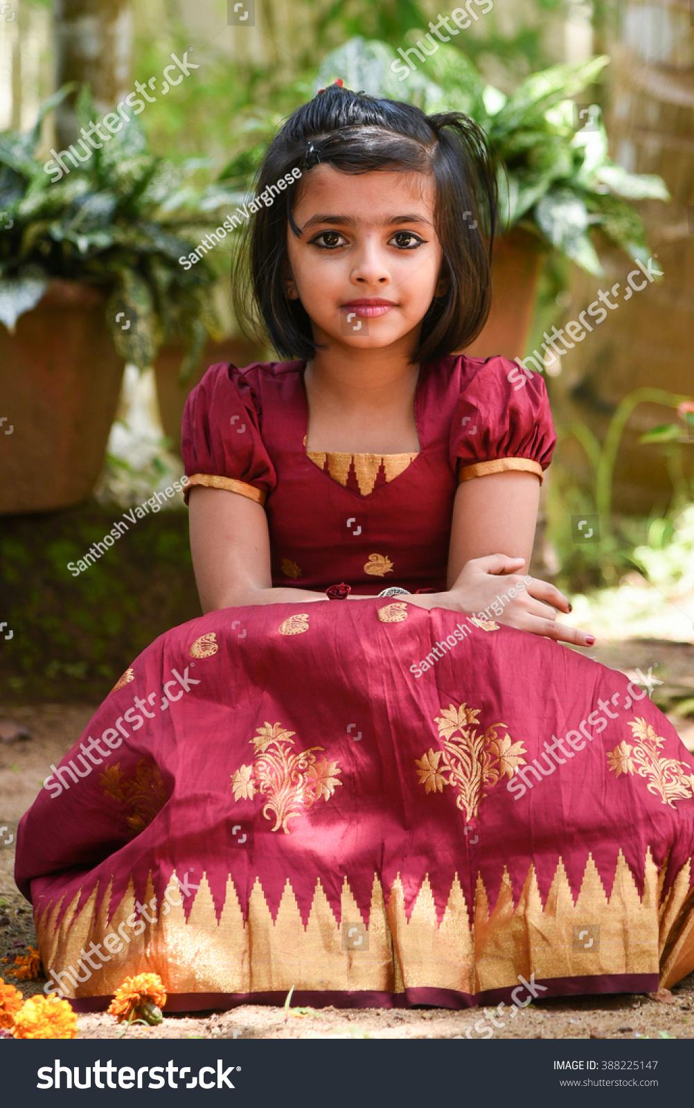 55926fa6fc Young Indian girl / child / kids wearing traditional dress for Onam, Vishu  Kerala India . Asian child. Beautiful daughter in traditional Indian sari  sitting ...