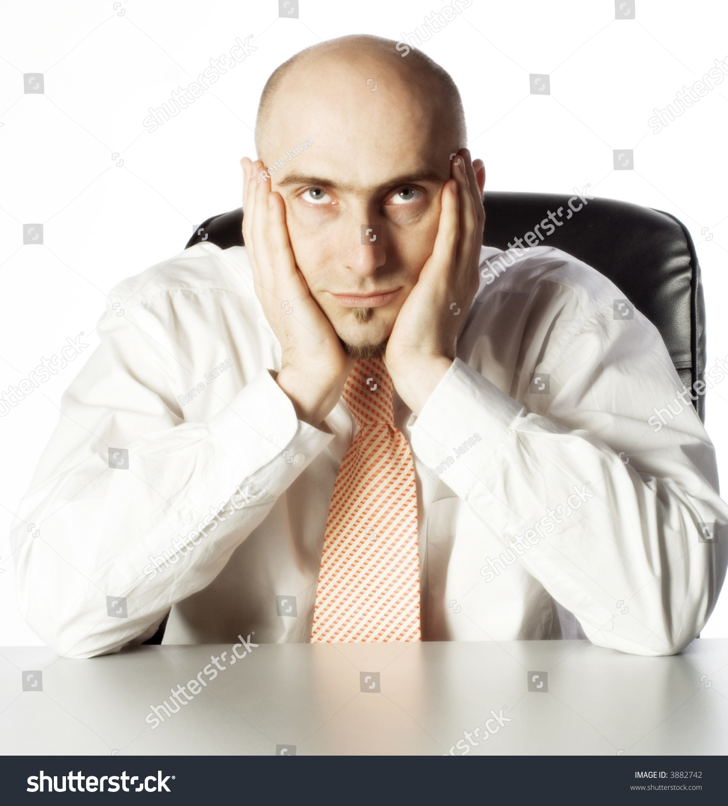 Technology Management Image: Businessman Sits Holding Face Hands Looking Stock Photo