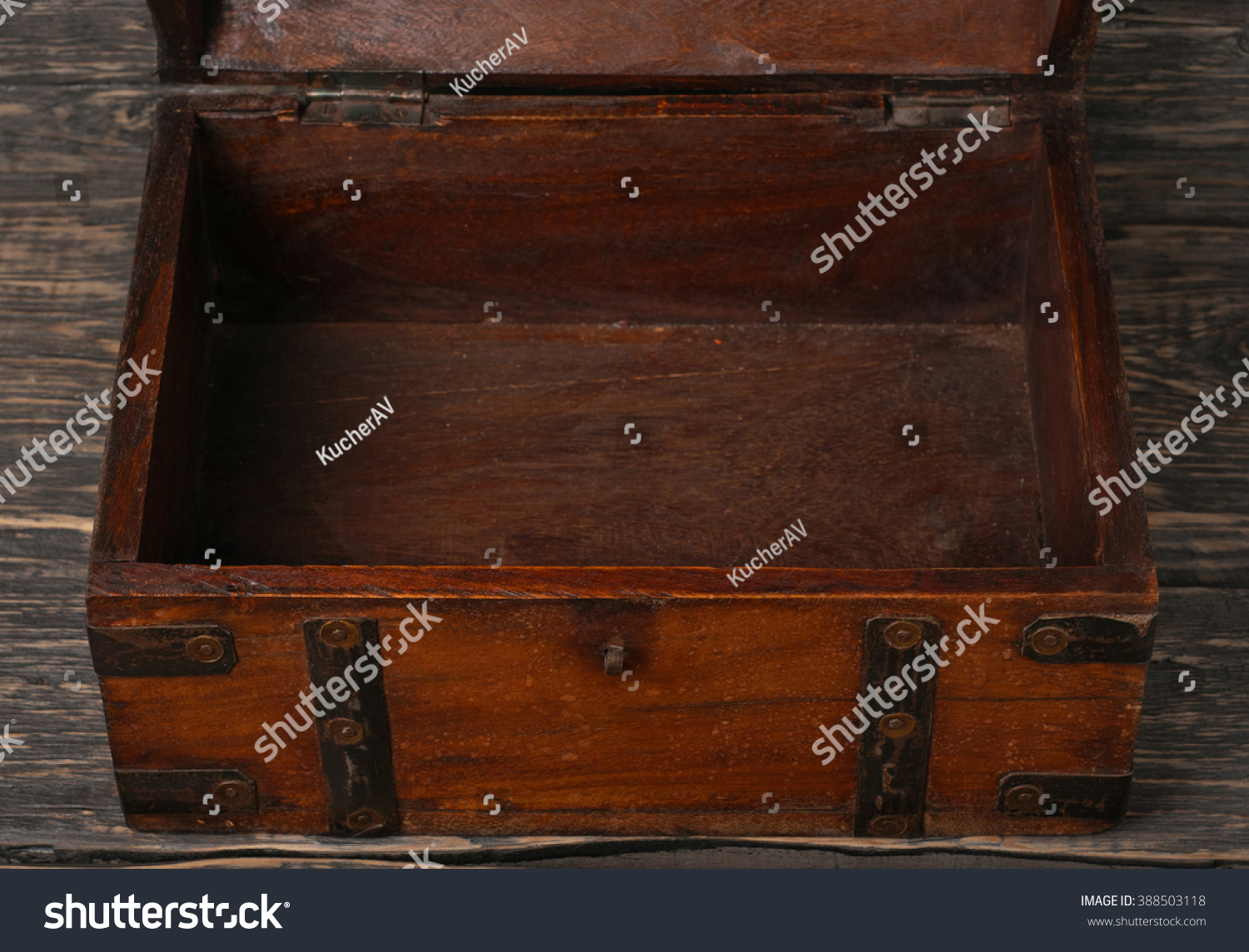 Dark wood table top - Old Open Wooden Chest On Dark Wooden Table Top View