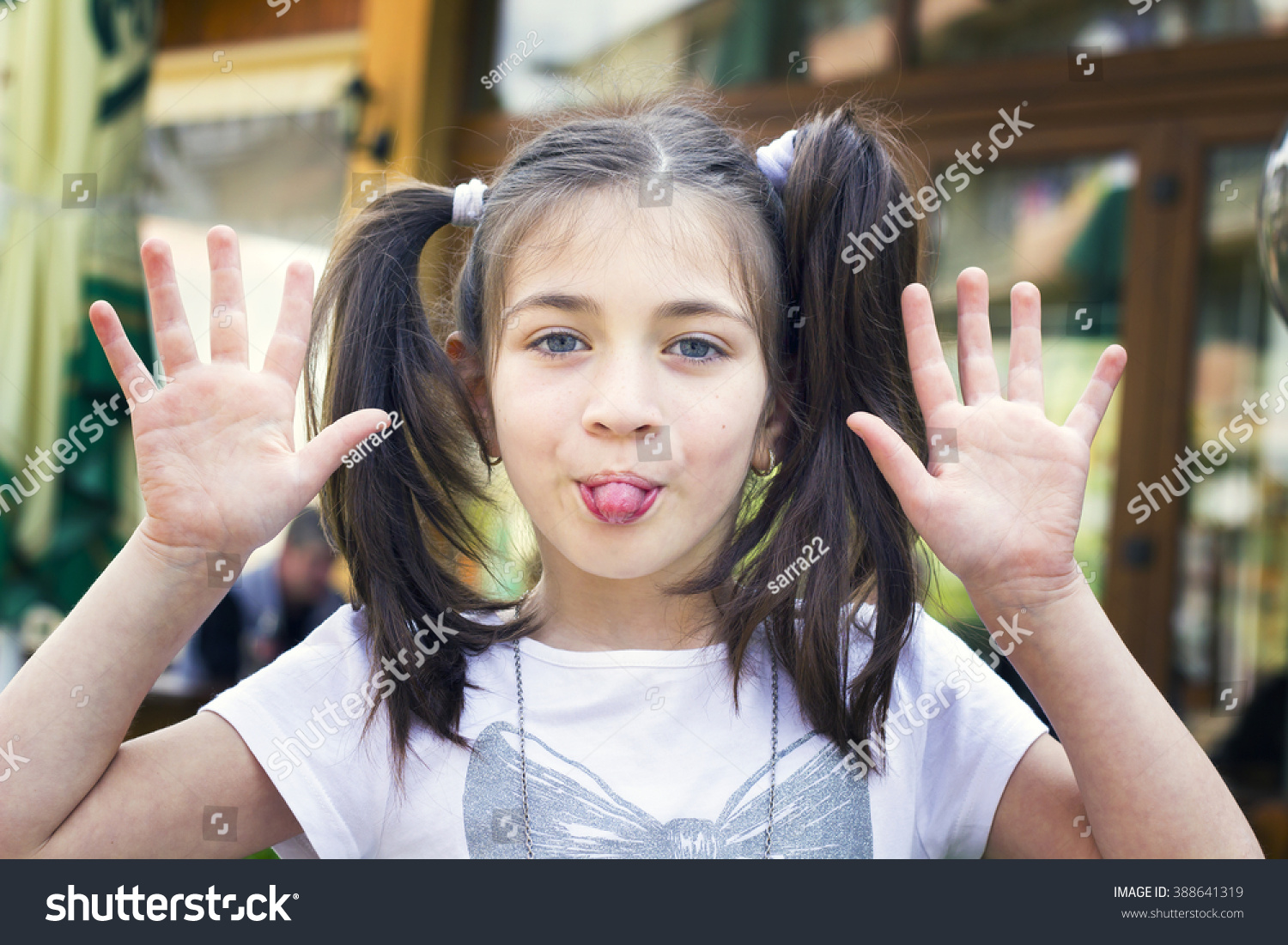 Grimace face clip art stock photo woman pulls a face in upset - Kid Girl Making A Face And Showing His Tongue