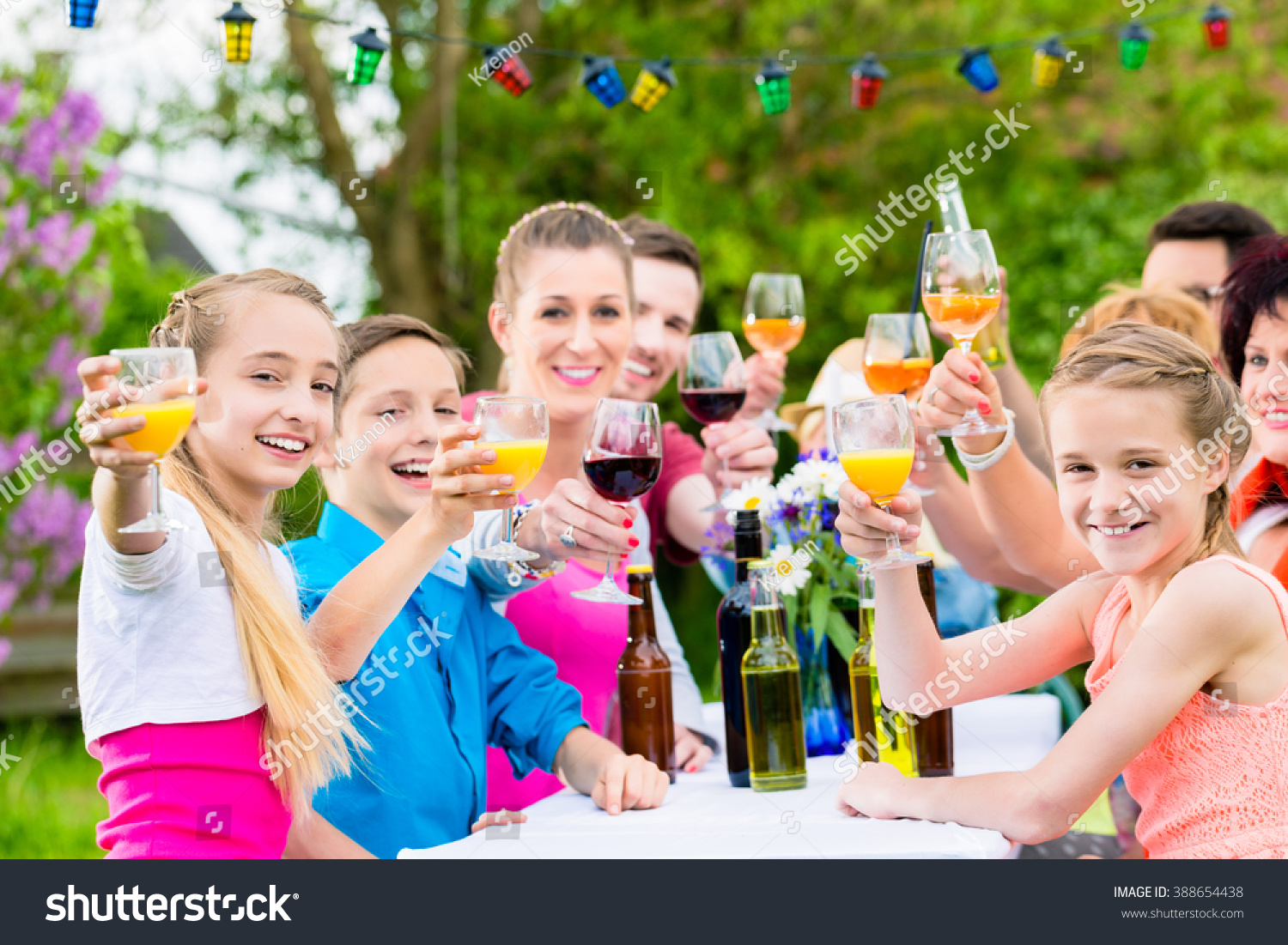 Friends and neighbors toasting on garden party #388654438