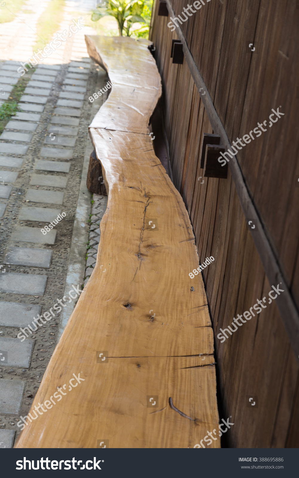 Astounding Long Wooden Log Seat Bench Beside Stock Photo Edit Now Ibusinesslaw Wood Chair Design Ideas Ibusinesslaworg