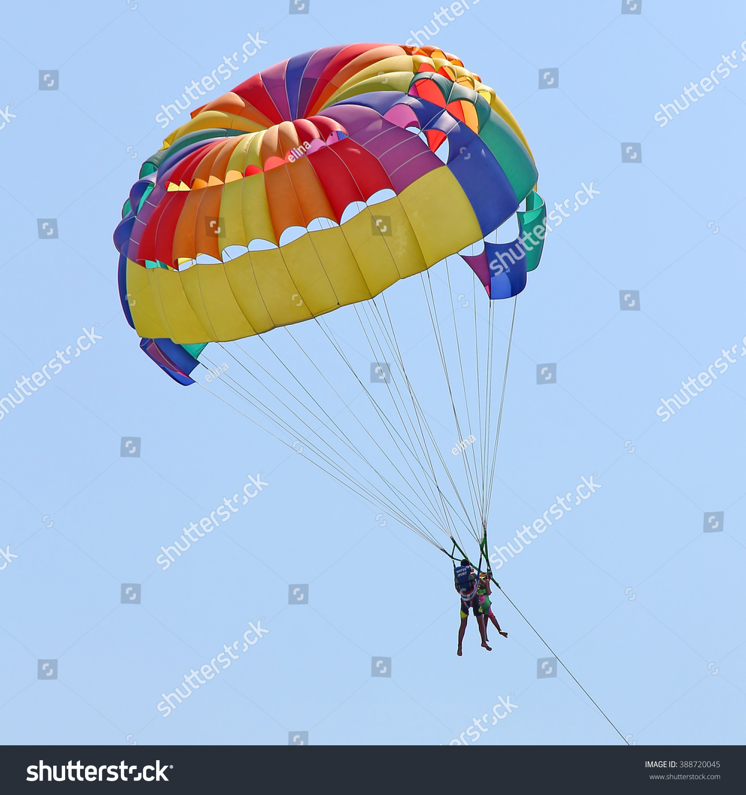 KEMER TURKEY AUGUST 18 2015 Parasailing in a blue sky near sea beach Parasailing is a popular recreational activity among tourists in Turkey
