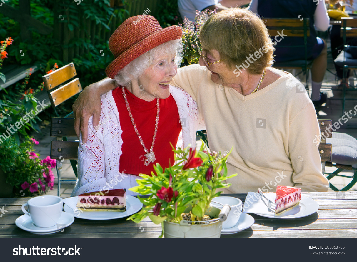 Woman hugging cute laughing friend in red hat in blouse at lunch with plates of cake  sc 1 st  Shutterstock & Woman Hugging Cute Laughing Friend Red Stock Photo 388863700 ...