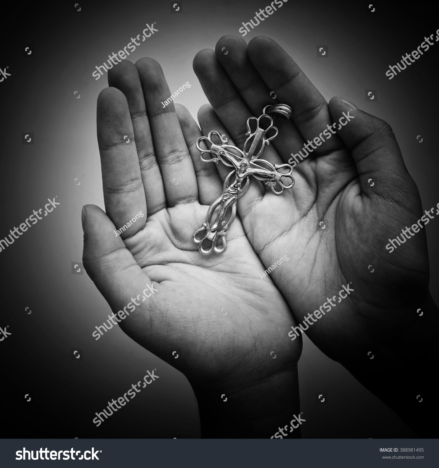lady hands holding silver jesus cross stock photo 388981495