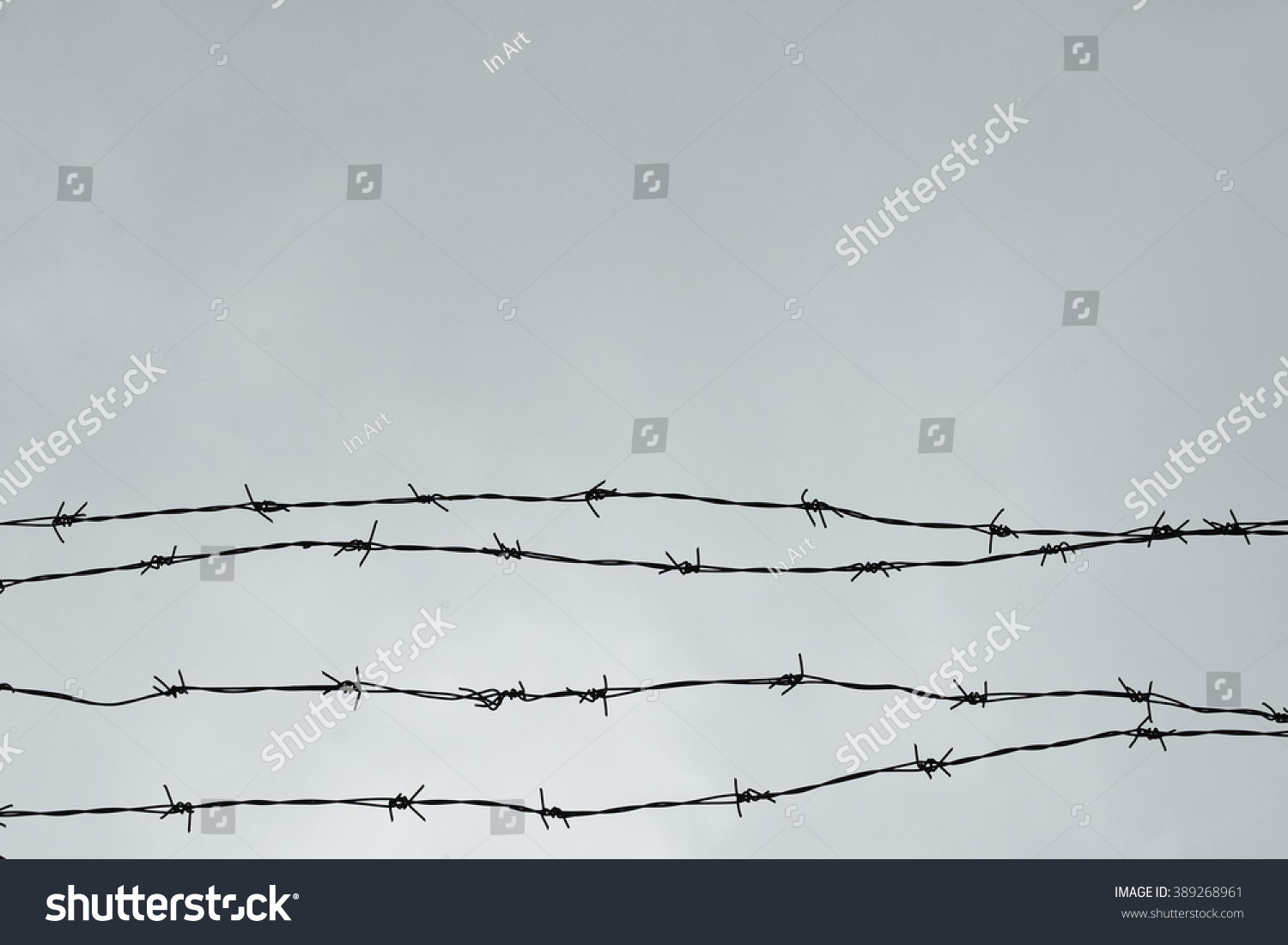 Royalty-free Fencing. Fence with barbed wire. Let.… #389268961 Stock ...