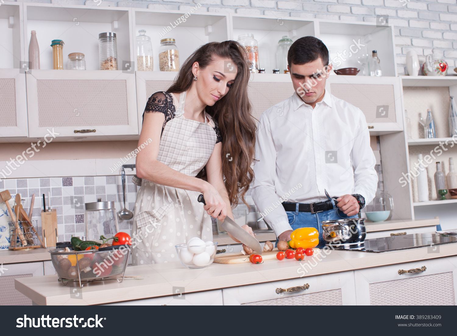 Happy Young Couple Prepares Romantic Dinner Stock Photo (Royalty ...