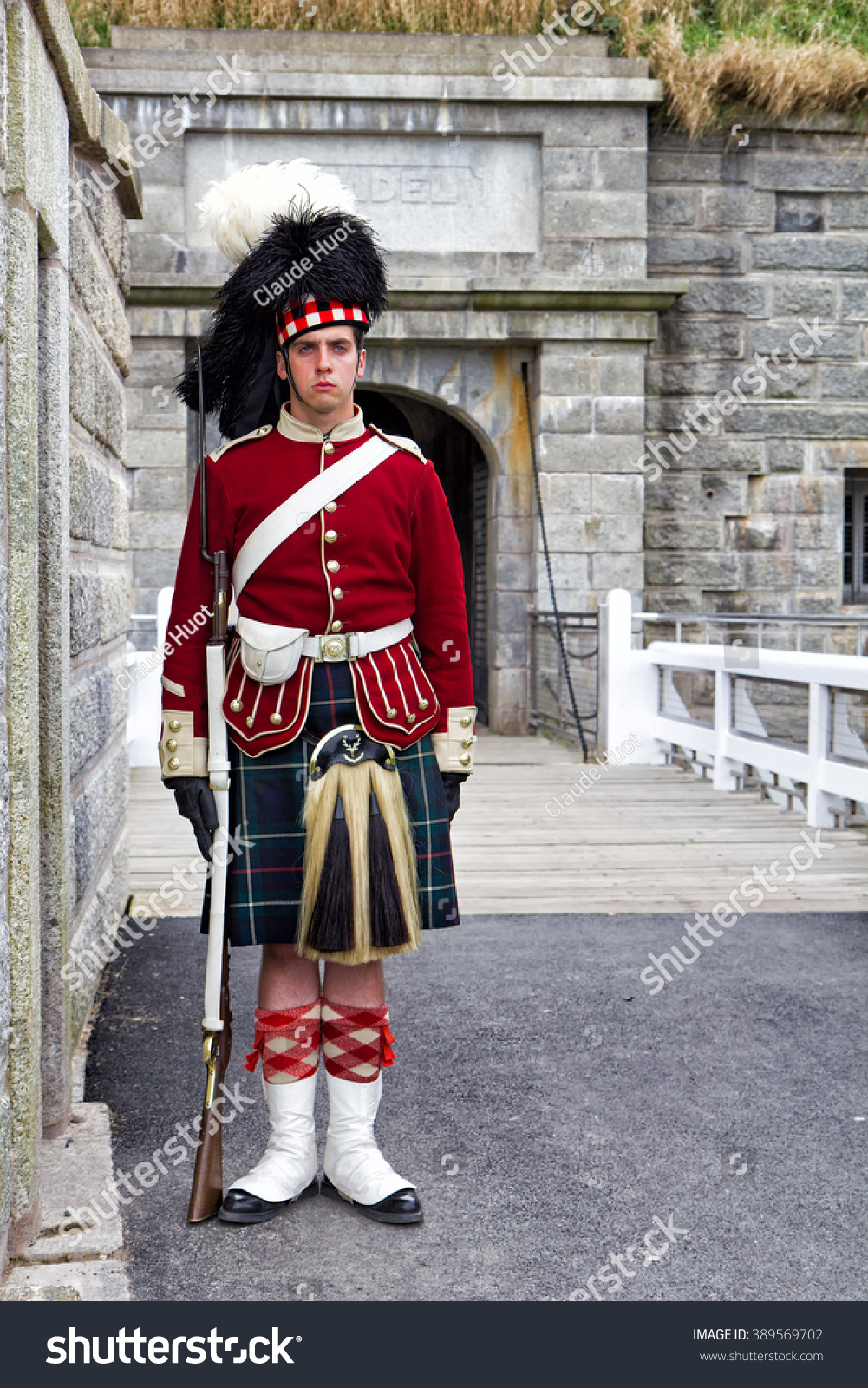 HALIFAX, NOVA SCOTIA, CANADA - SEPTEMBER 19, 2011: A Canadian sentry guards the entrance to the Citadel (Fort George) in Halifax, Canada. This is a National Historic Site and a tourist attraction.