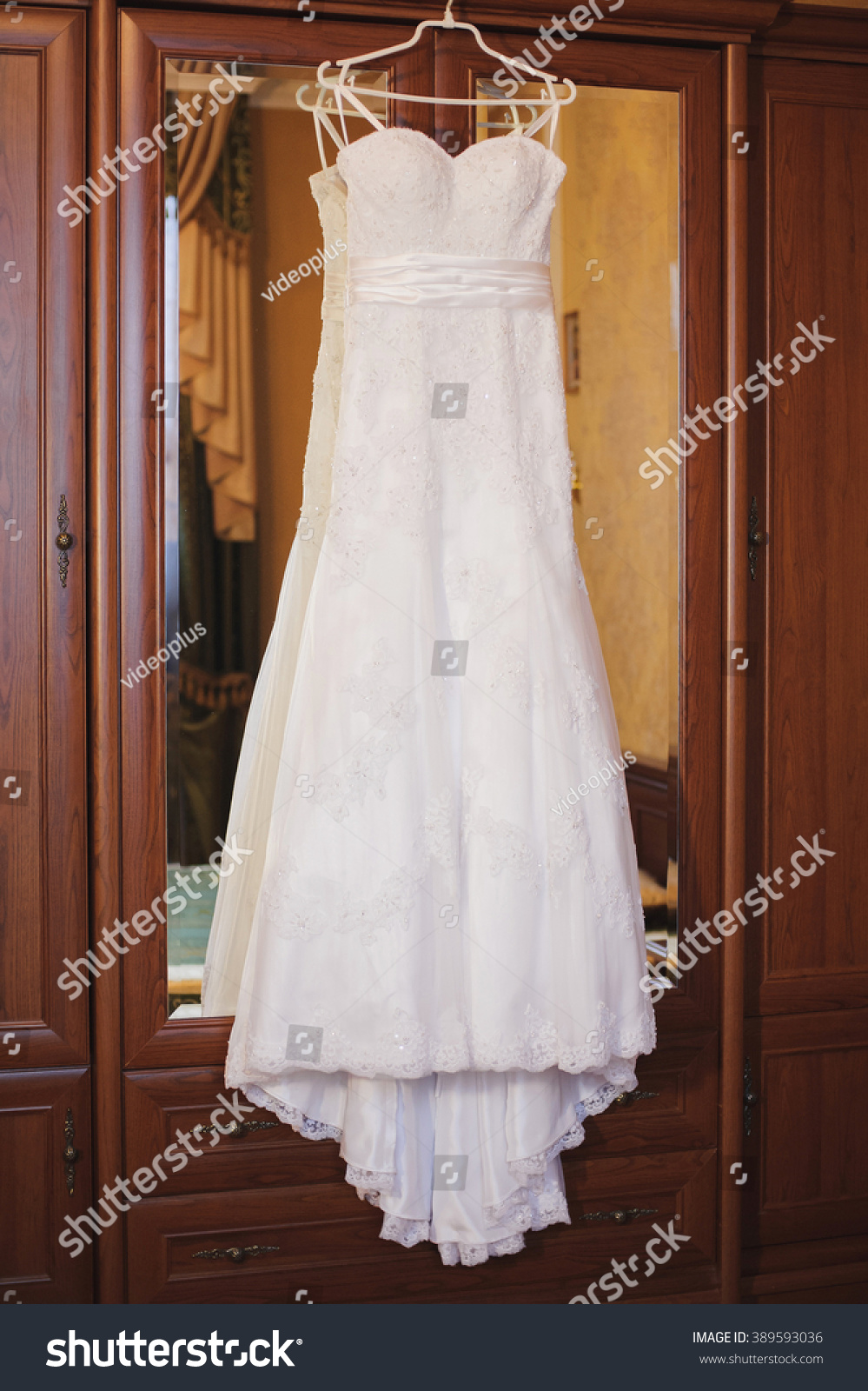 IWhite Wedding Dresses Hanging In The Closet Beautiful Dress With A Train