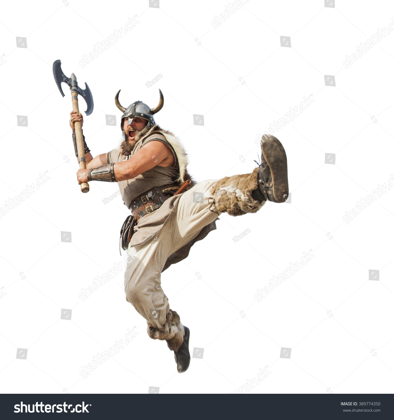 crazy strong viking with traditional costume attacking studio shot isolated on white background looking at camera with angry eyes