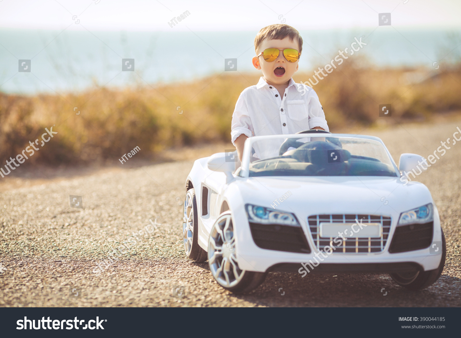 funny boy car driver steering wheel stock photo 390044185 shutterstock. Black Bedroom Furniture Sets. Home Design Ideas