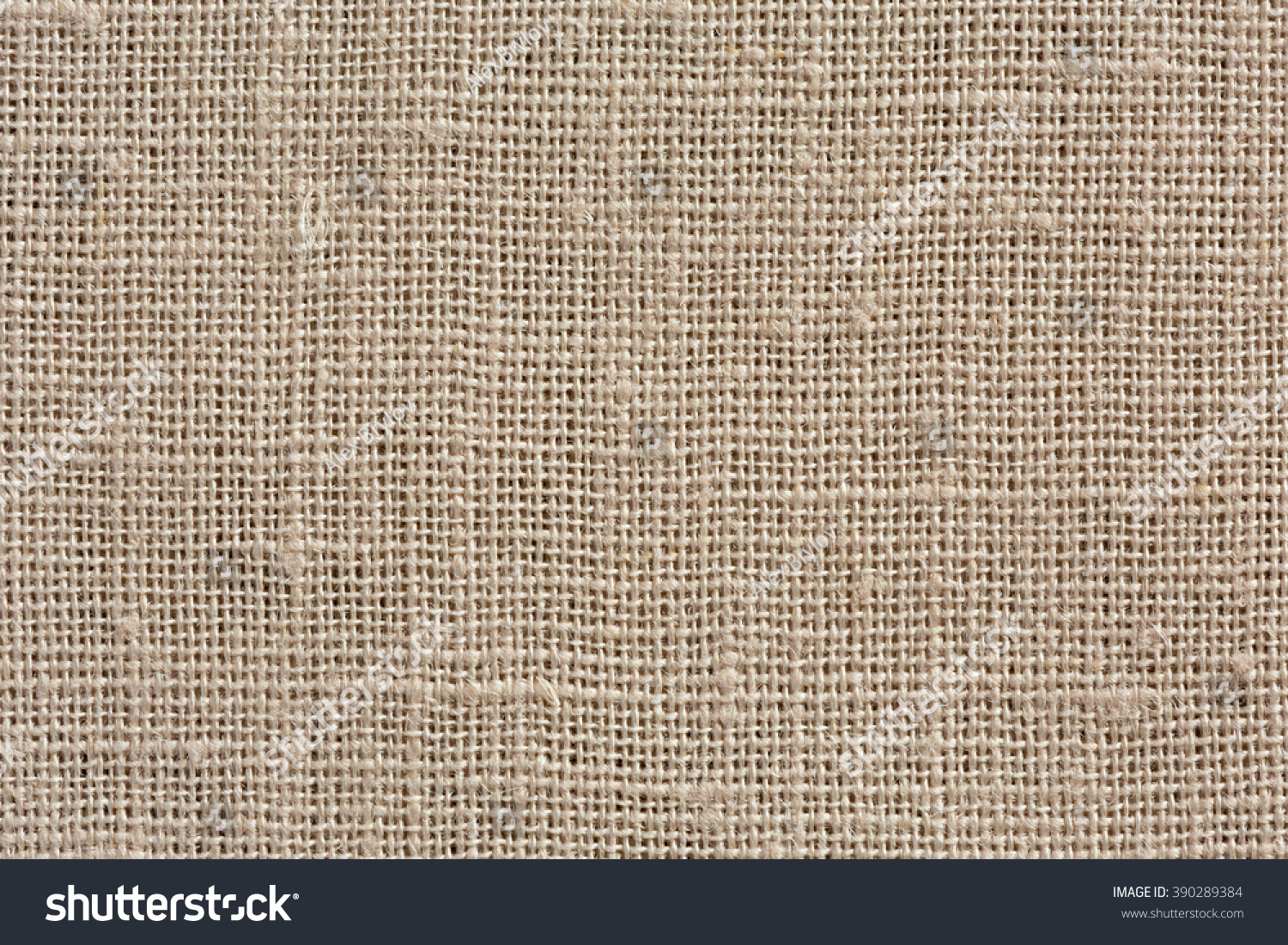 neutral light brown linen fabric background with clear canvas texture close up brown linen fabric lighting