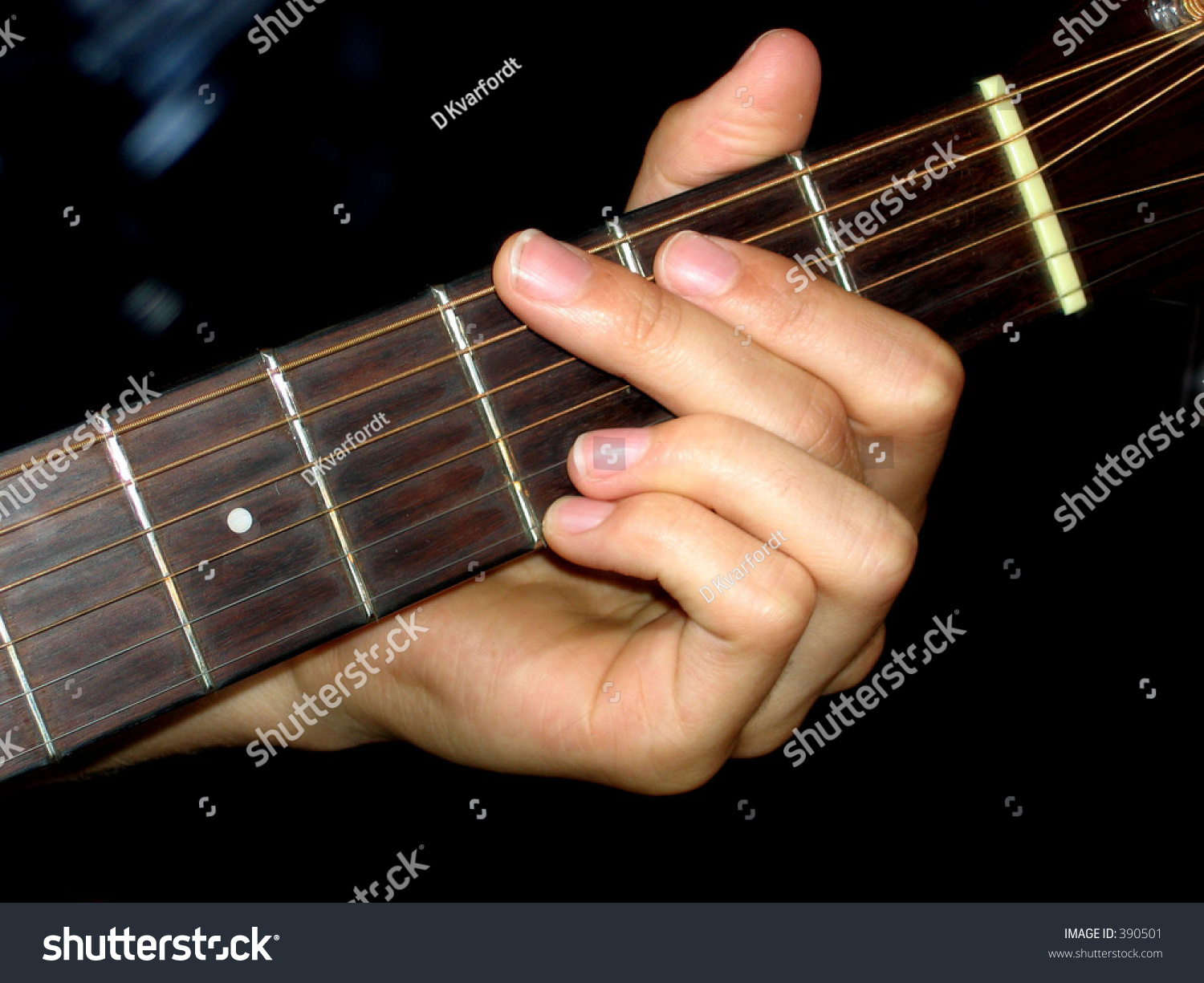 Hand taking guitar chord g major stock photo 390501 shutterstock a hand taking a guitar chord g major hexwebz Choice Image