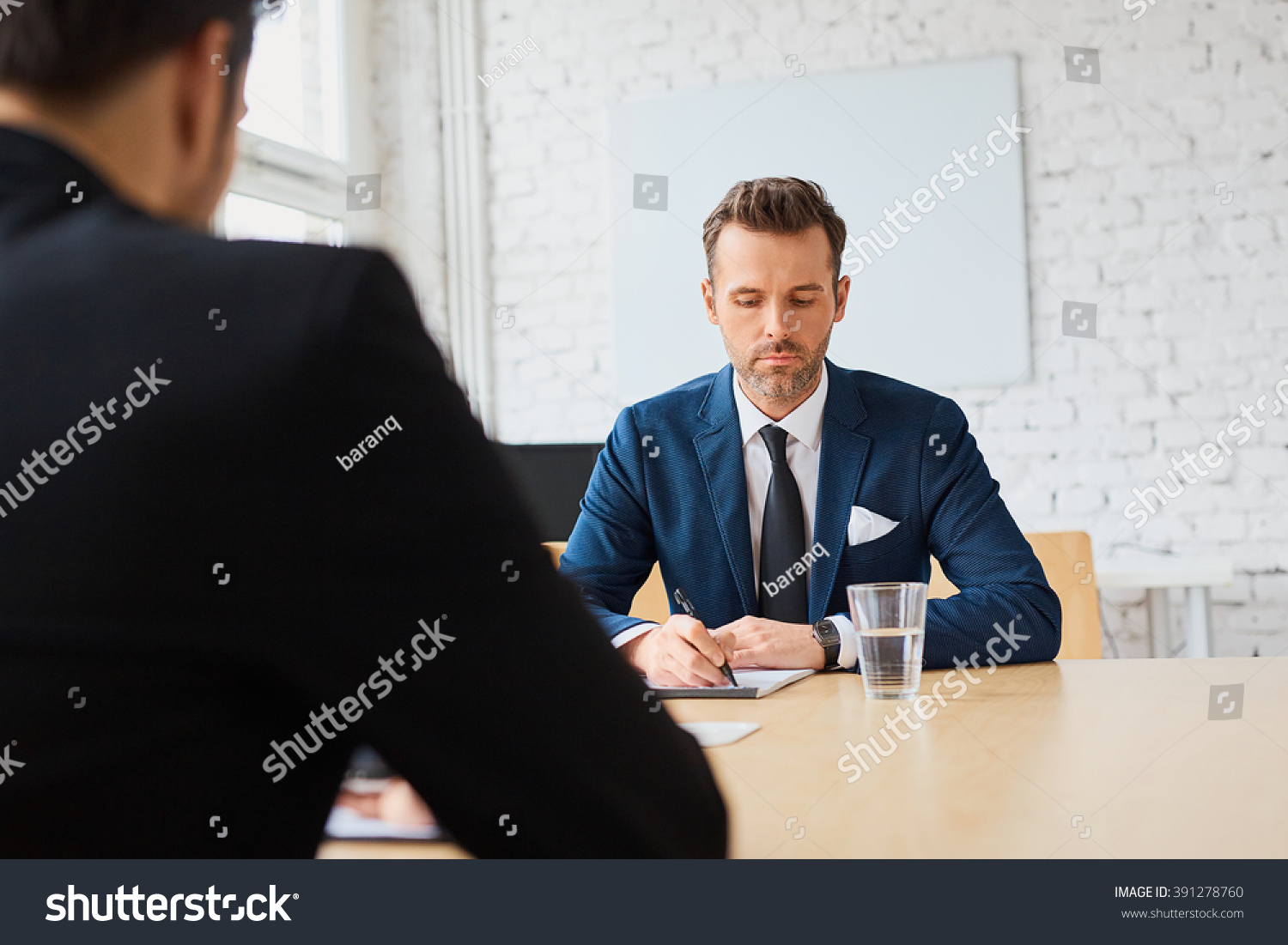 royalty job interview recruiter writing down  job interview recruiter writing down candidate answers 391278760