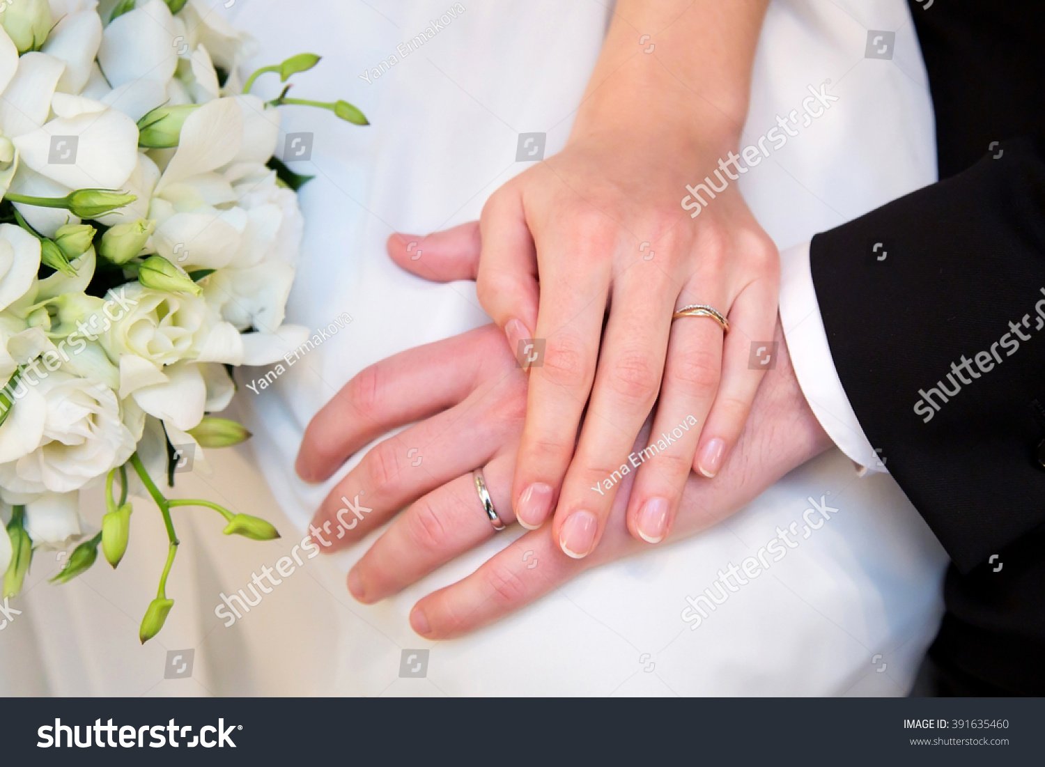 Hands newlyweds with wedding rings on background wooden texture | EZ ...