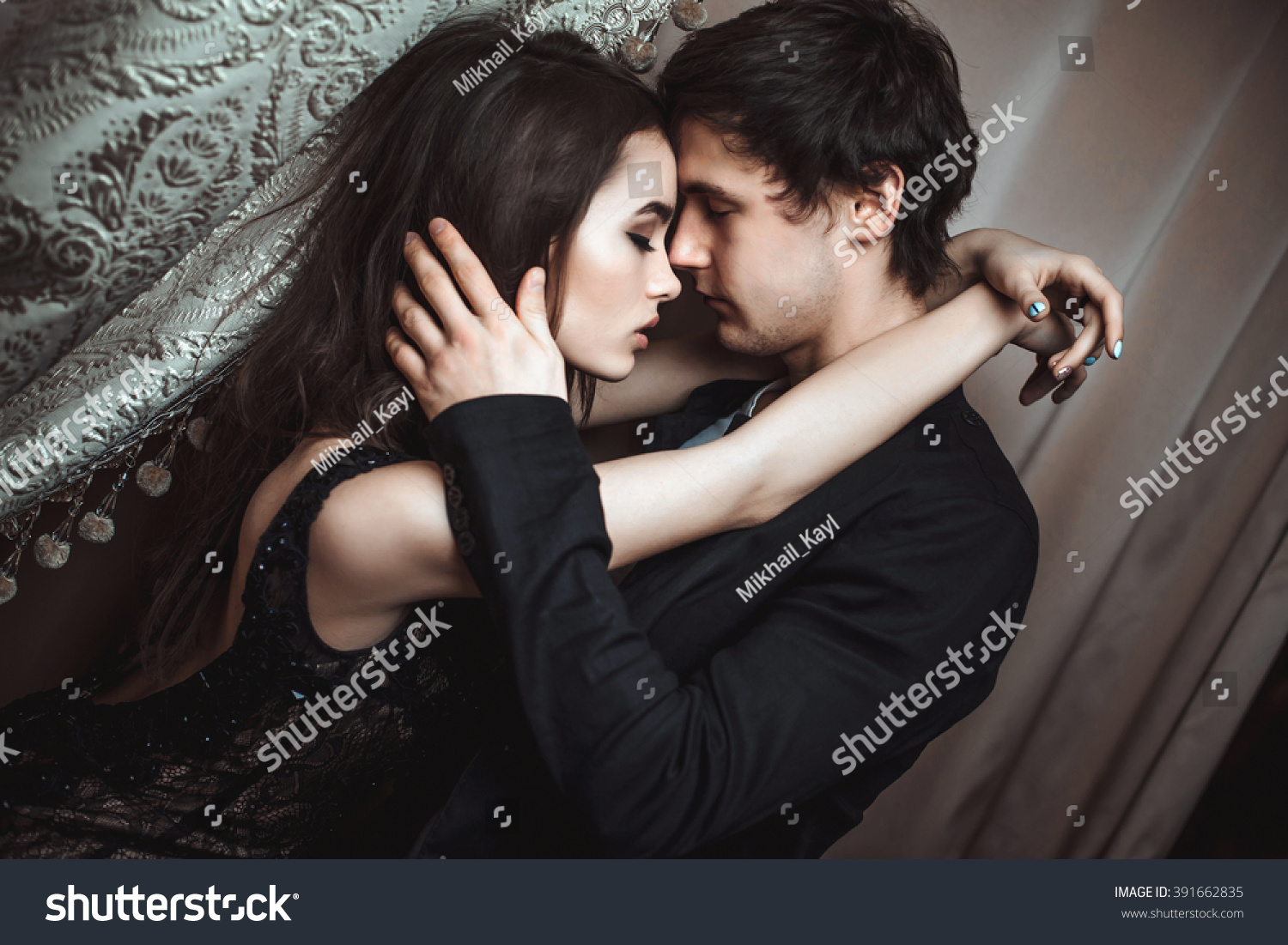 young beautiful pair lovers hug kiss stock photo (royalty free