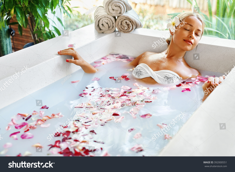 6e973af5bb60a Spa Relaxation. Woman Body Care. Beautiful Sexy Caucasian Blonde Girl In  Bikini Lying In Flower Bath In Resort Day Spa Salon. Beauty Treatment