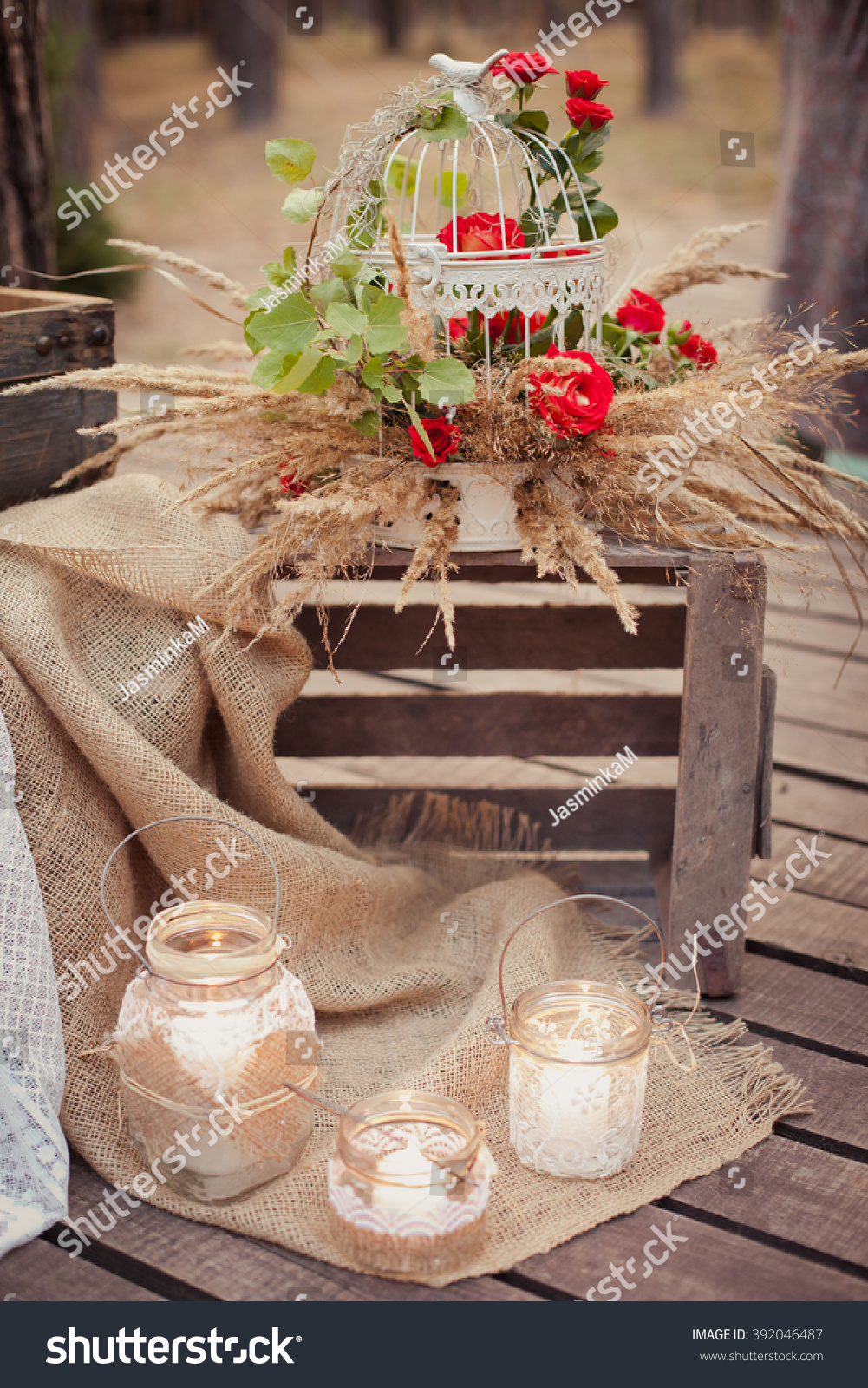 Wedding ceremony & Wedding decorations in rustic style. Romantic decor with candles #392046487