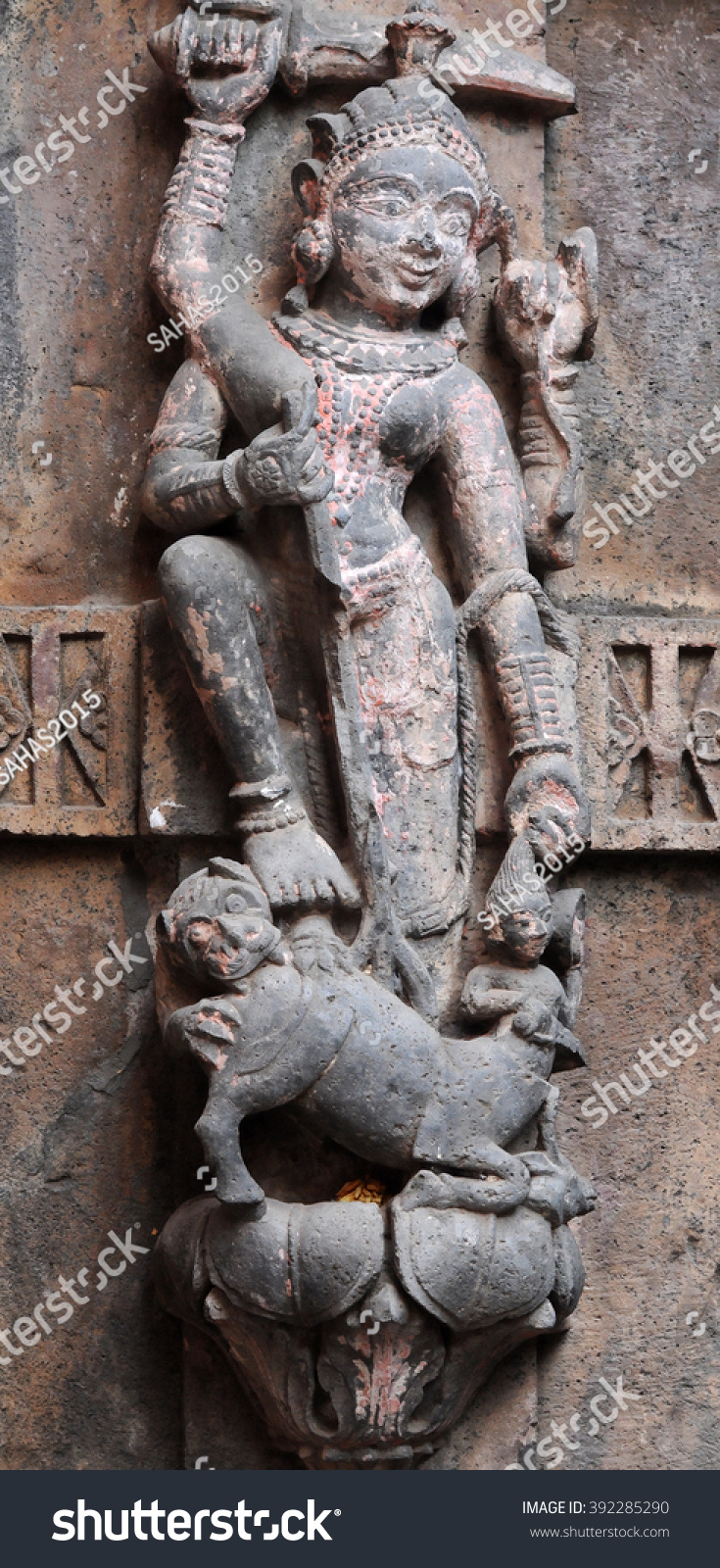 Hindu gods on carved stone wall stock photo
