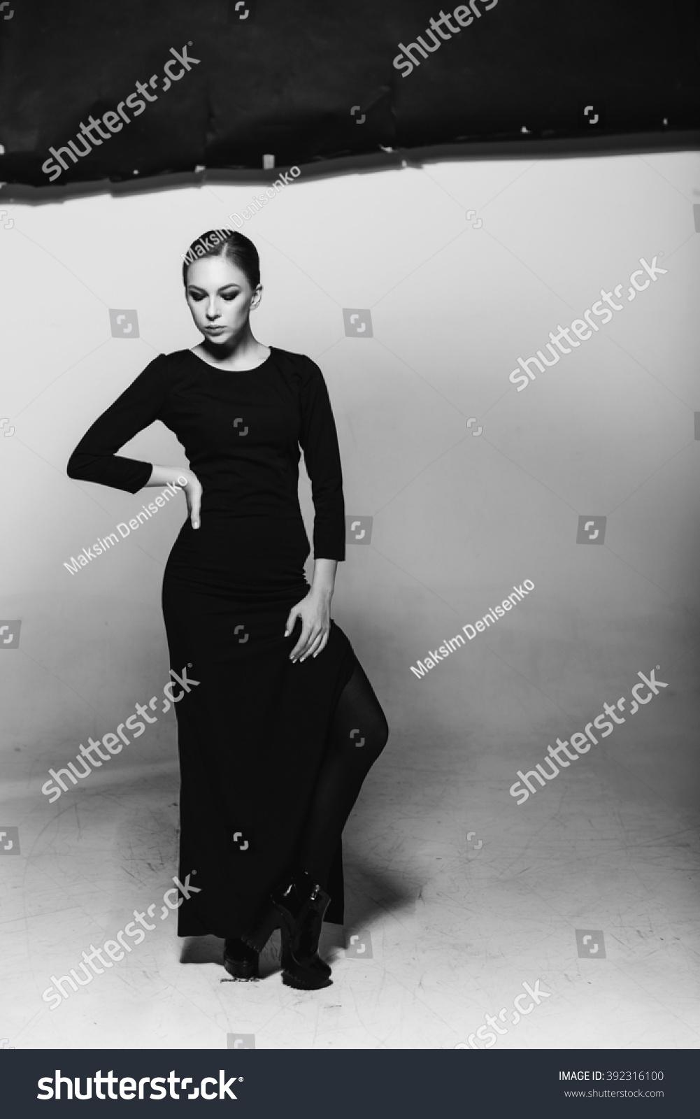 Charismatic womandramatic poses black and white photo studio photography negativity