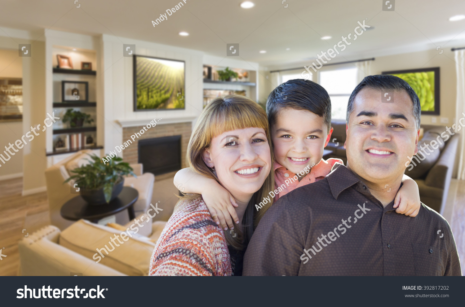 Happy Young Mixed Race Family Portrait In Living Room of Home