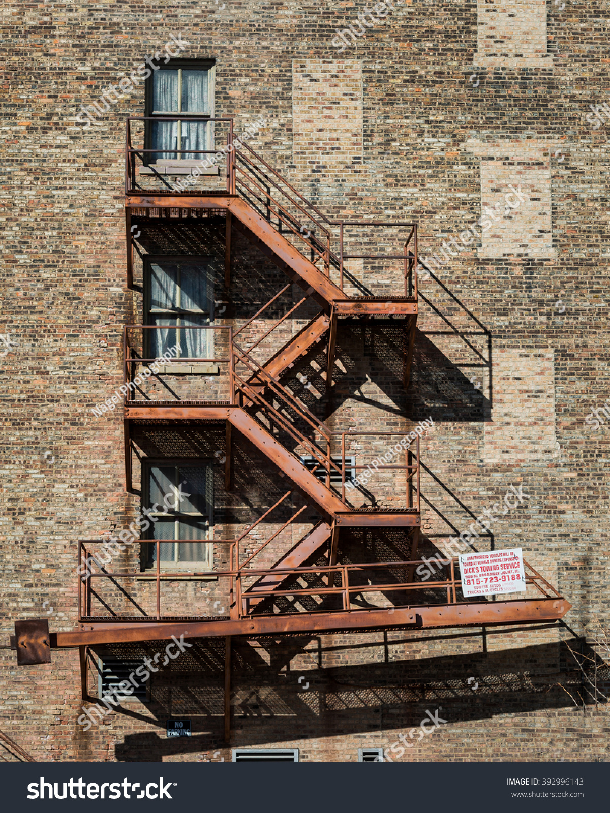 JOLIET, ILLINOIS   MARCH 17: Fire Escape Staircase On Outside Of Brick  Building On