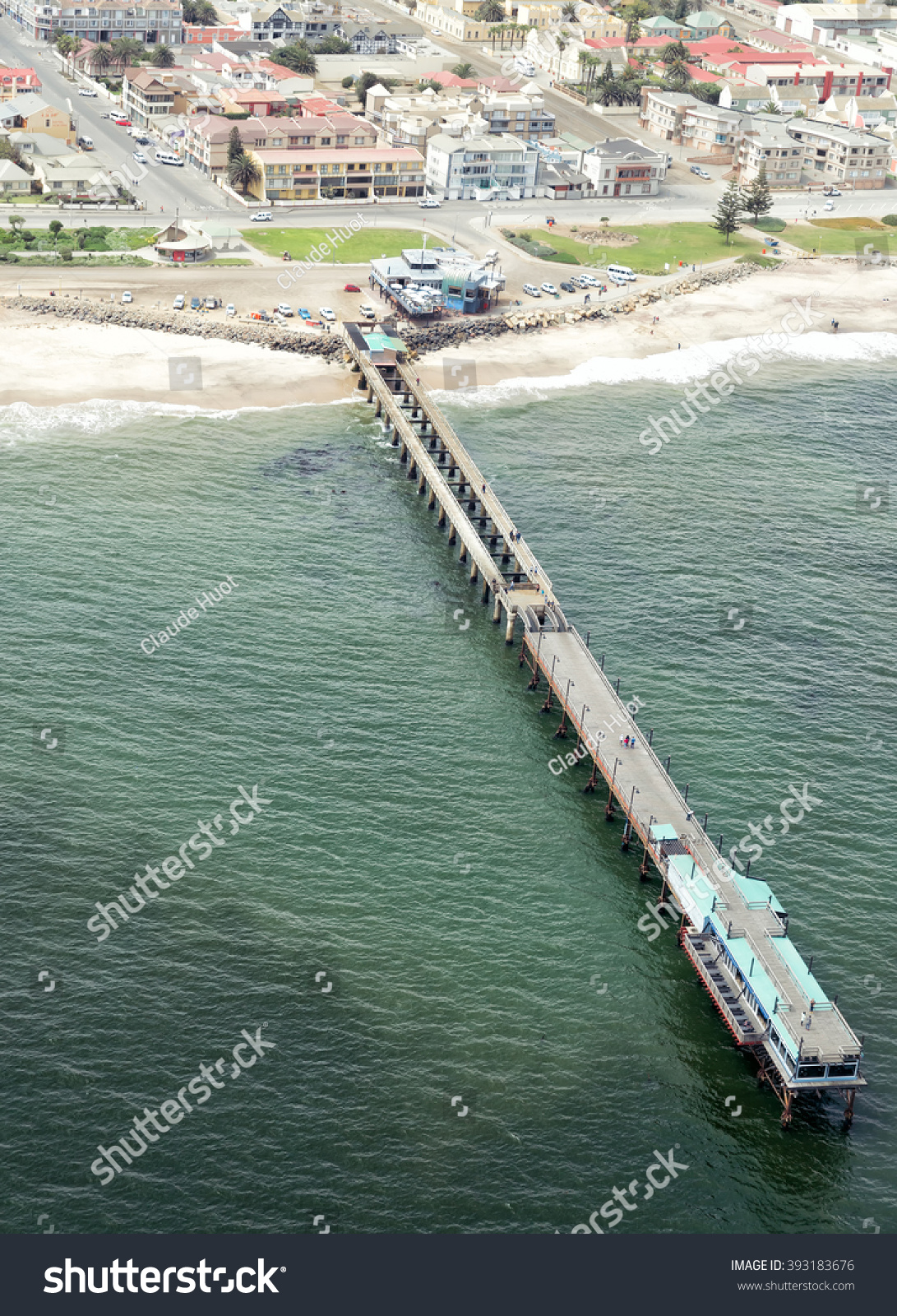 """SWAKOPMUND, NAMIBIA - SEPTEMBER 5, 2015 - Aerial view of the jetty in Swakomund, Namibia with the """"Jetty 1905"""" restaurant at the end. This is a very popular restaurant with tourists."""