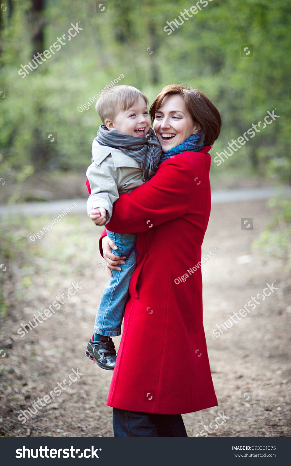 Mom In The Red Coat Is Holding His Son They Laugh And Play