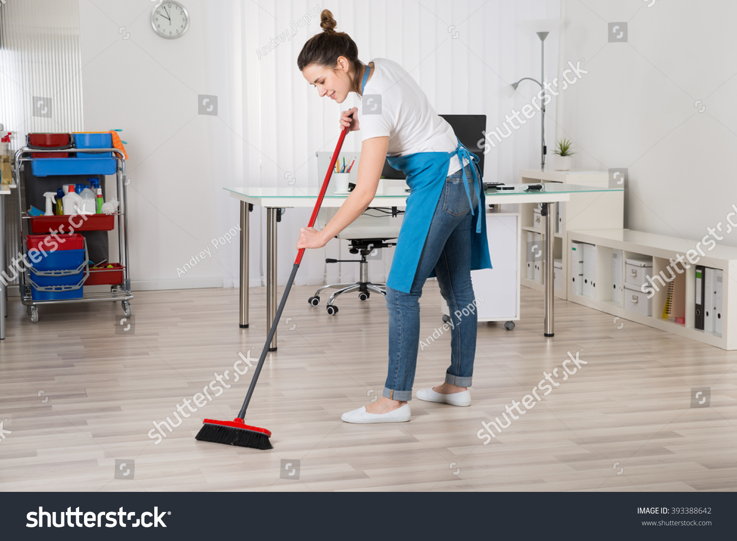 young female janitor sweeping floor broom stock photo edit now 393388642 https www shutterstock com image photo young female janitor sweeping floor broom 393388642