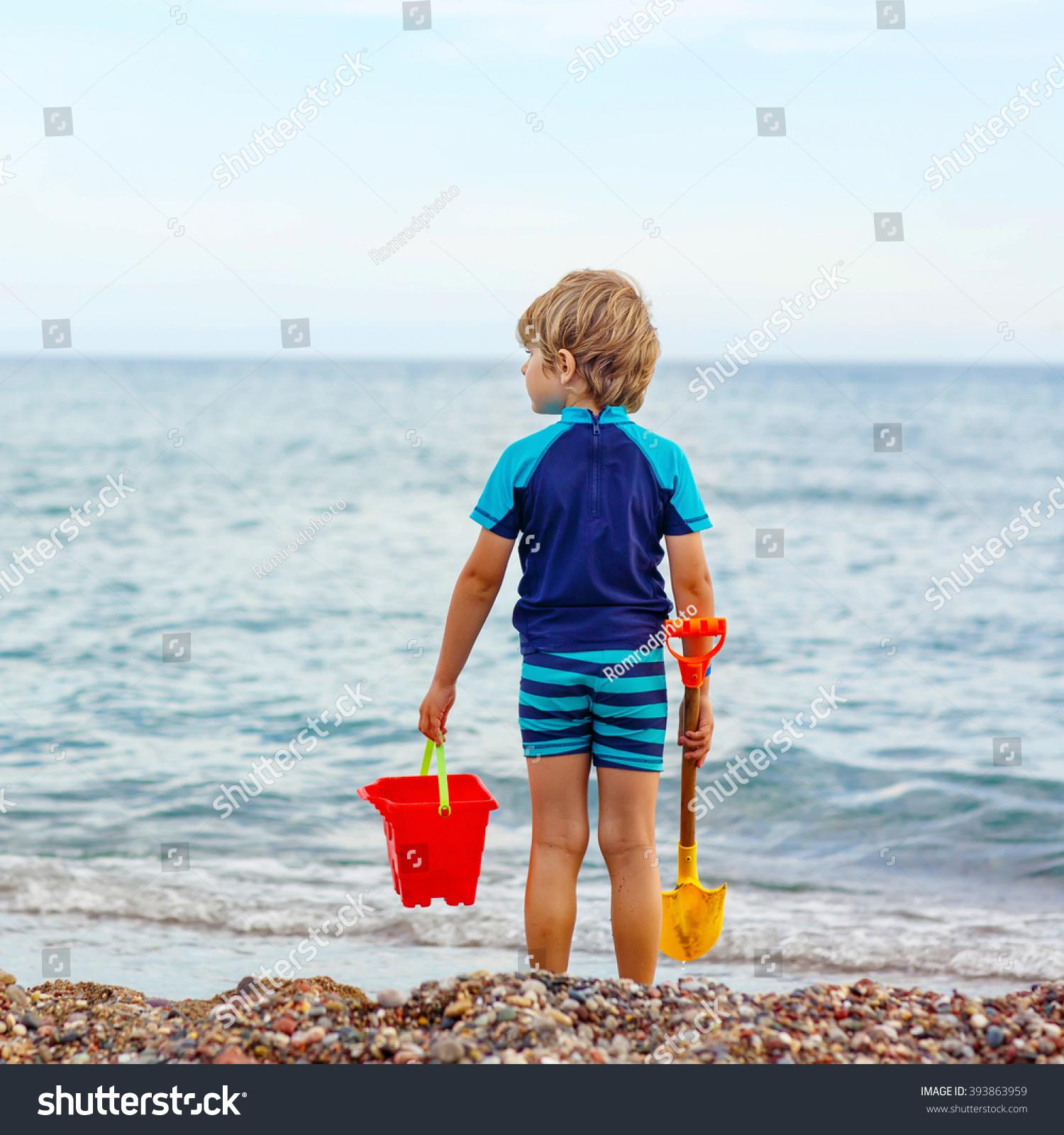 Adorable Little Blond Kid Boy Standing Stock Photo